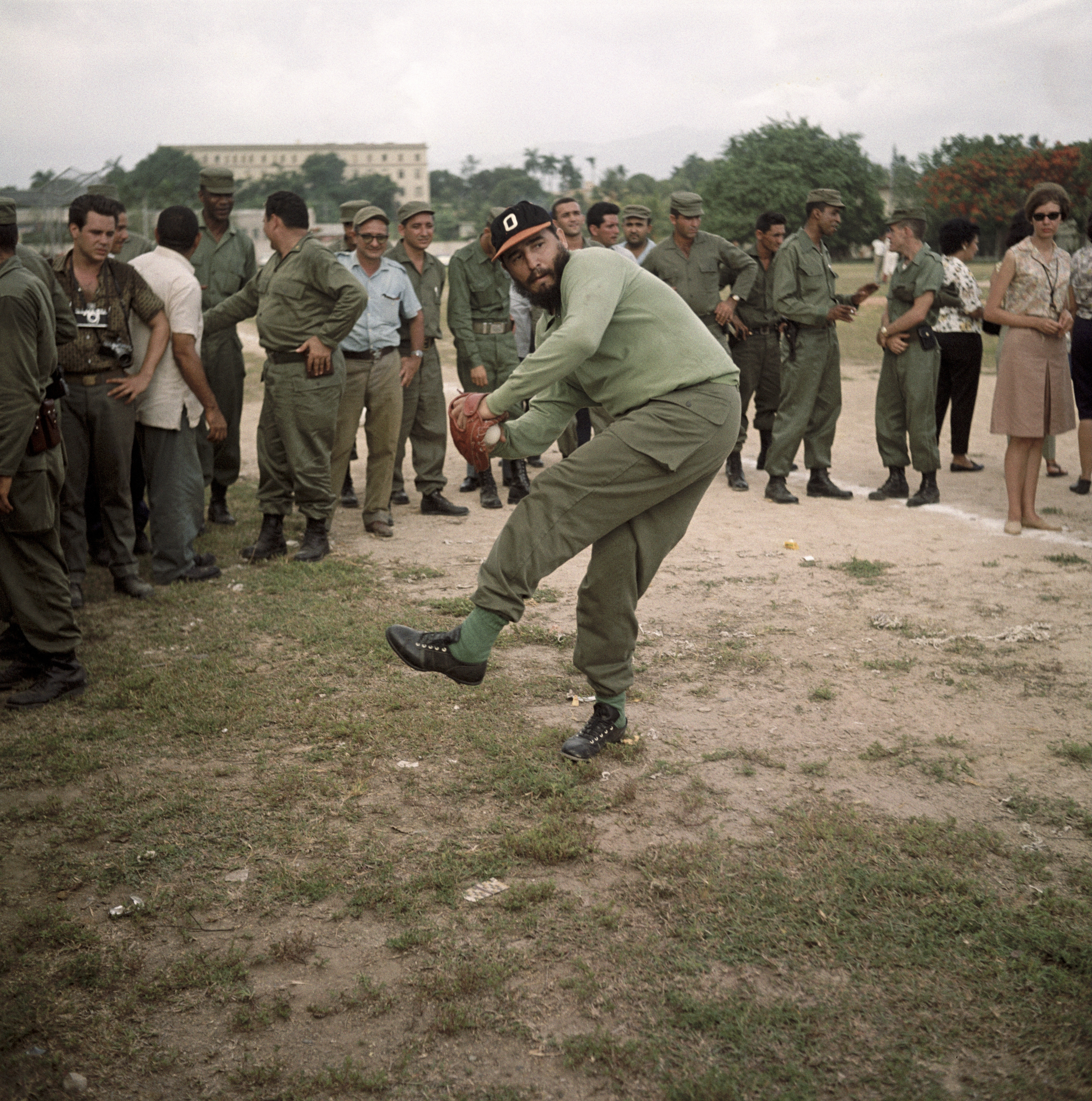 Cuban leader Fidel Castro winds up to throw a baseball in 1964.