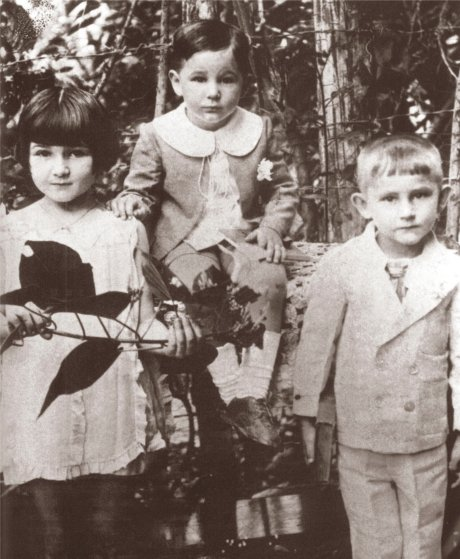 Fidel Castro, age 3, is seated in between his sister, Angelita, 6, and brother Ramon, 4, in 1929.