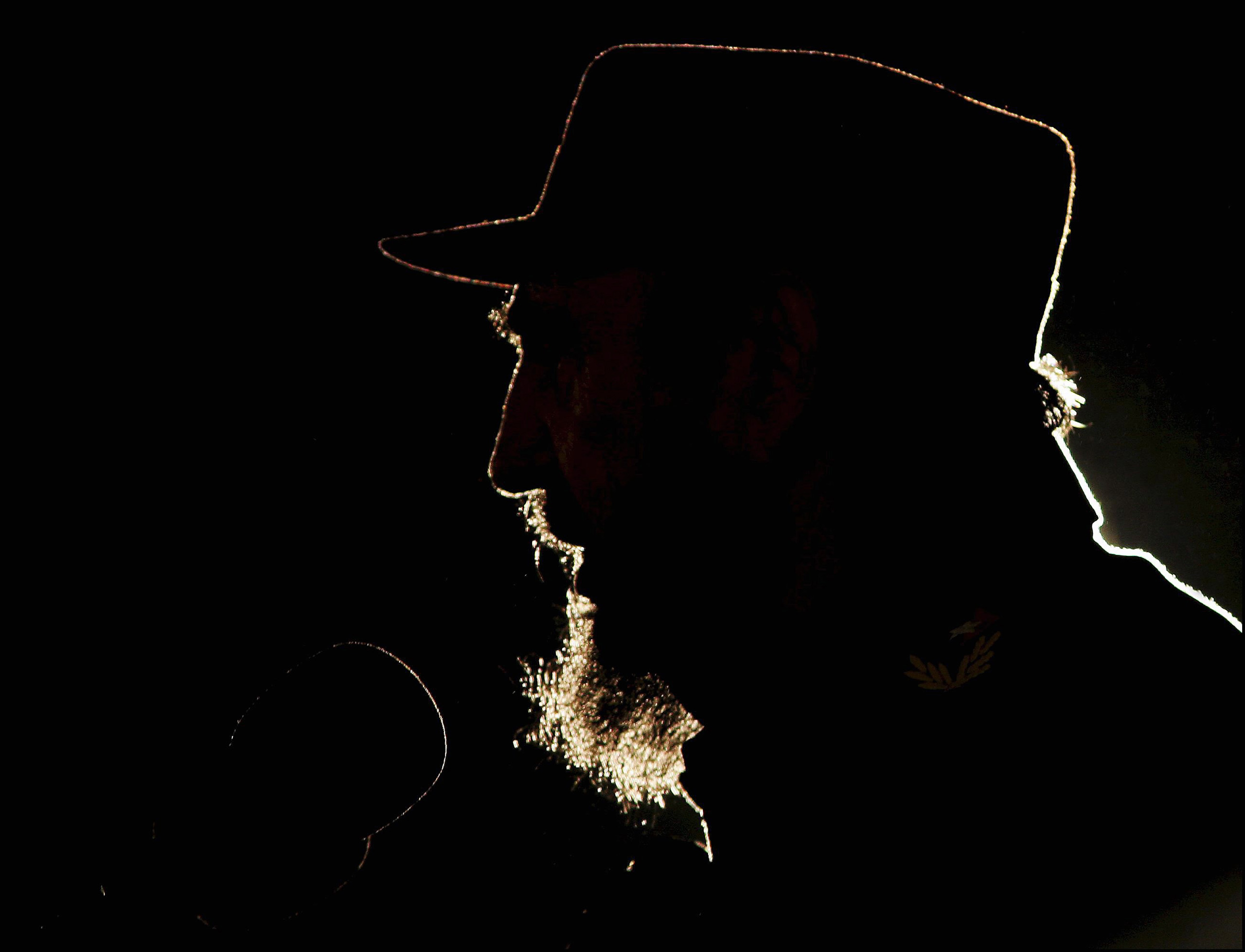 Cuban President Fidel Castro delivers a speech in Havana on Feb. 2, 2006, as Venezuelan President Hugo Chavez, having just been likened to Adolf Hitler by the Bush administration, received a U.N. prize named for Cuban independence hero Jose Mart'i.