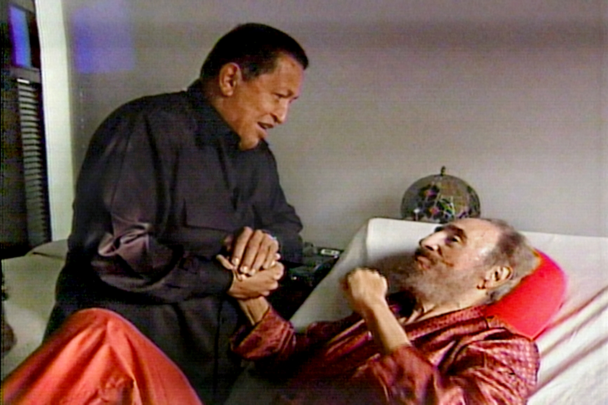 A screen grab from state-owned Cuban television shows late Venezuelan President Hugo Chavez holding the hand of Fidel Castro, his Cuban counterpart, in his sickbed in Havana on Sept. 1, 2006. Chavez visited Castro, who is recovering from intestinal surgery, on a stopover in Havana on his way back from a 10-day trip to China, Malaysia, Syria and Angola.