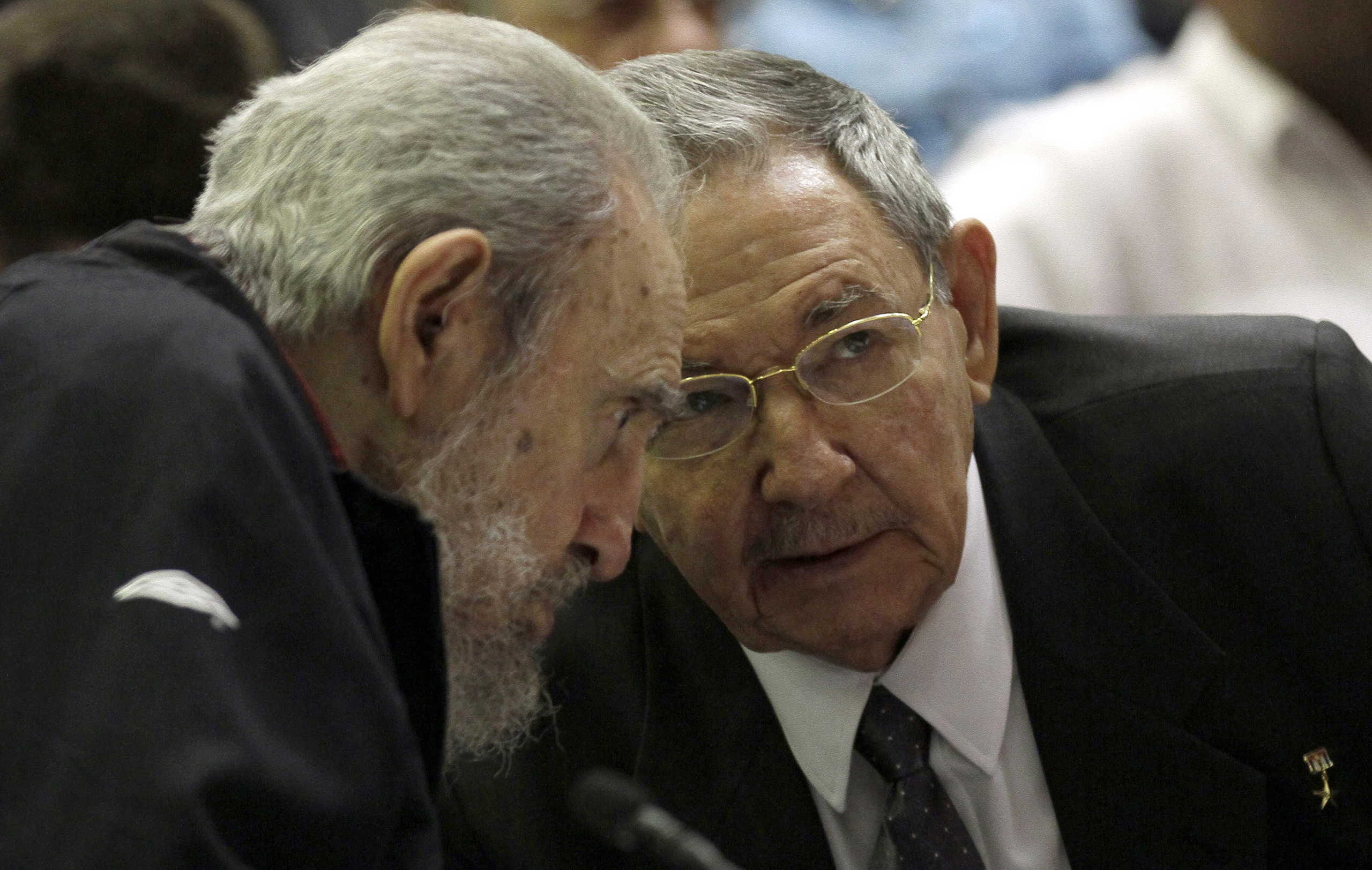 Cuban President Raul Castro speaks with his brother, Fidel Castro, during the opening session of the National Assembly in Havana on Feb. 24, 2012. Raul Castro was named to a new five-year-term as president.