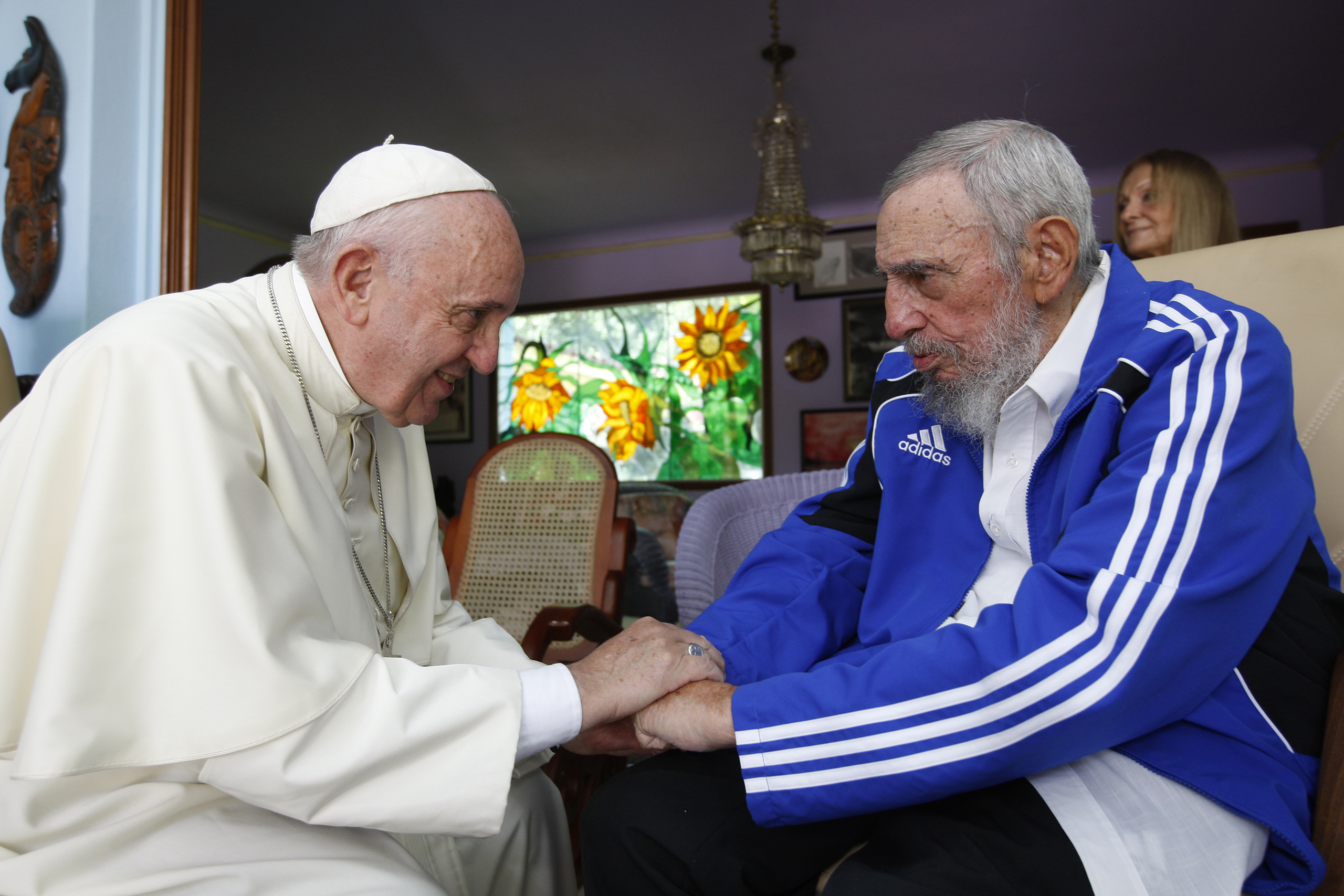 Pope Francis and Fidel Castro embrace hands at a 40-minute meeting inside Castro's residence during the pontiff's trip to Havana on Sept. 20, 2015.