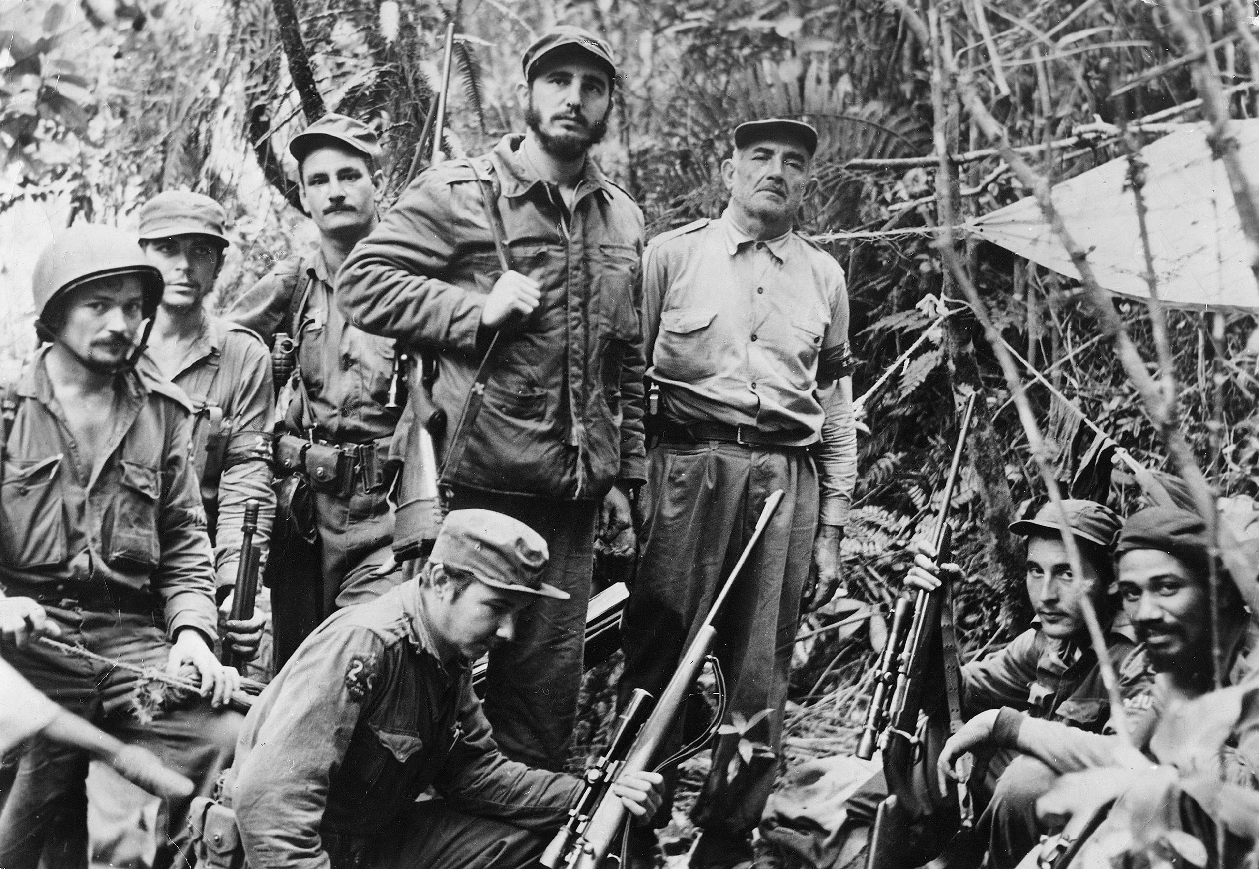 Fidel Castro with his command staff in a secret jungle hideout, 1958. From left: Guillermo Garcia, Ernesto Che Guevara, Universo Sanchez, Raul Castro (kneeling), Castro, Crescentio Perez, George Sotus and Juan Almeide.