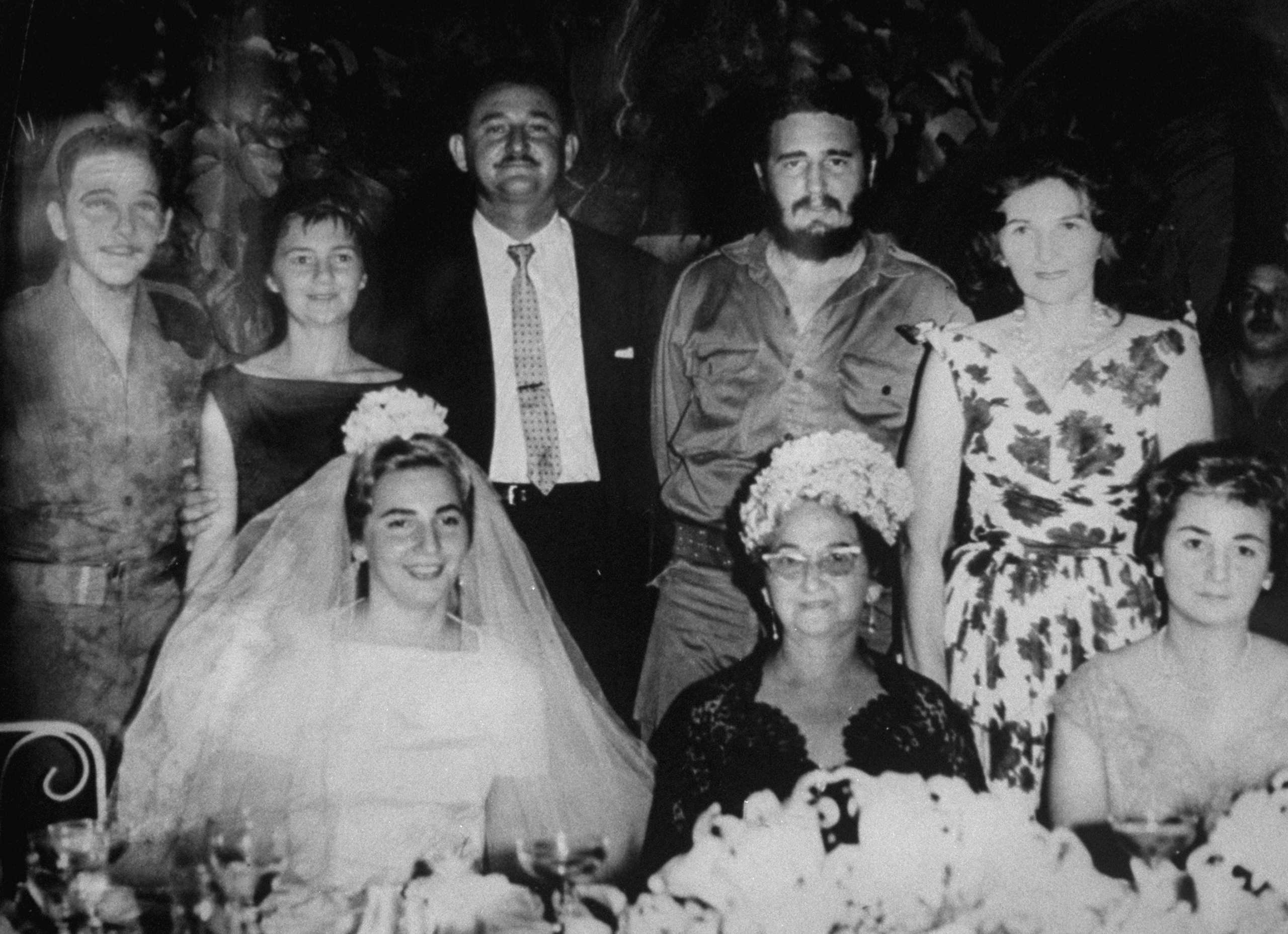 Fidel Castro, second from right in back row, attends the wedding of a sister.