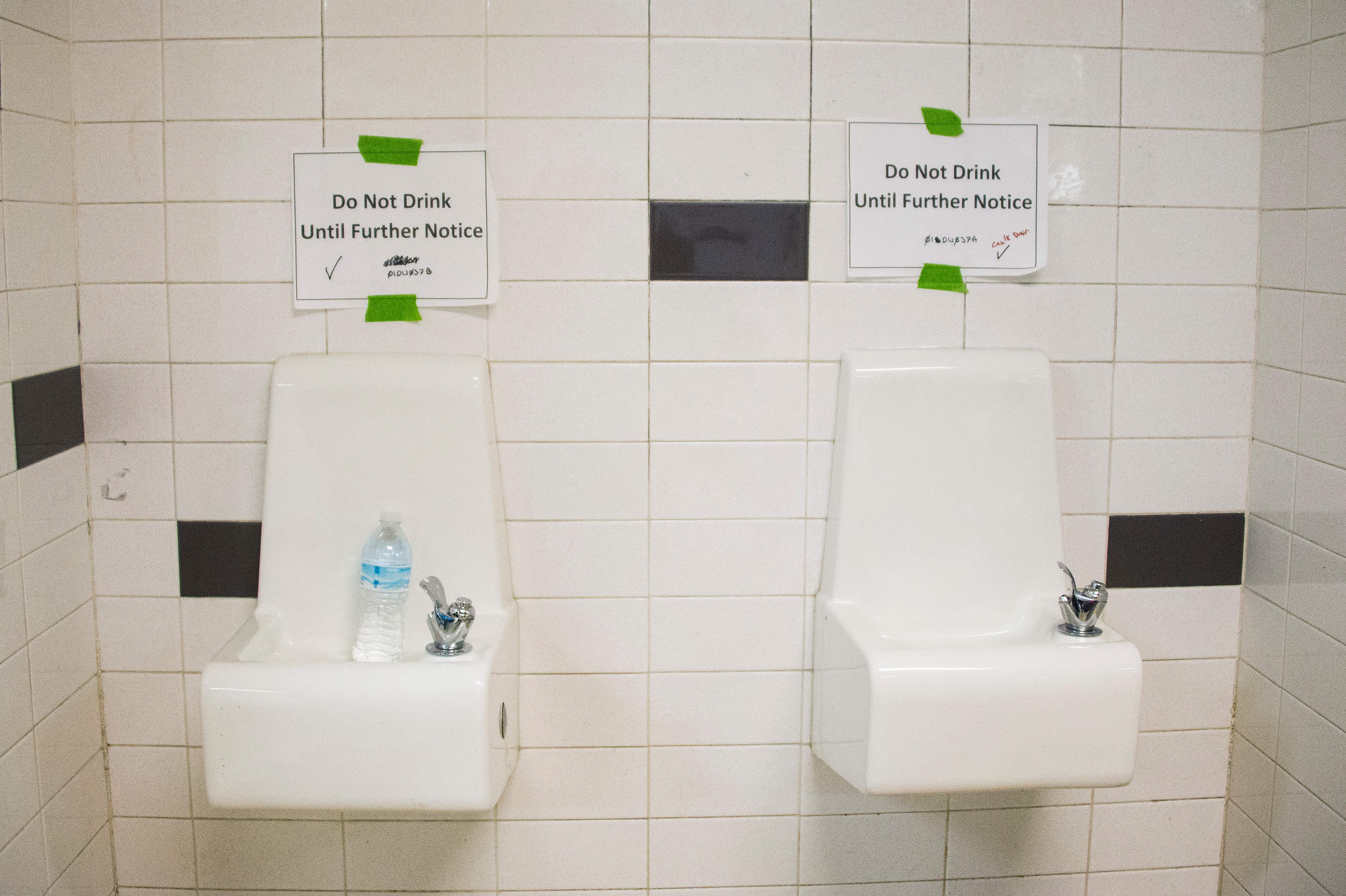 Placards posted above water fountains warn against drinking the water at Flint Northwestern High School in Flint, Michigan, May 4, 2016, where US President Barack Obama met with locals for a neighborhood roundtable on the drinking water crisis.