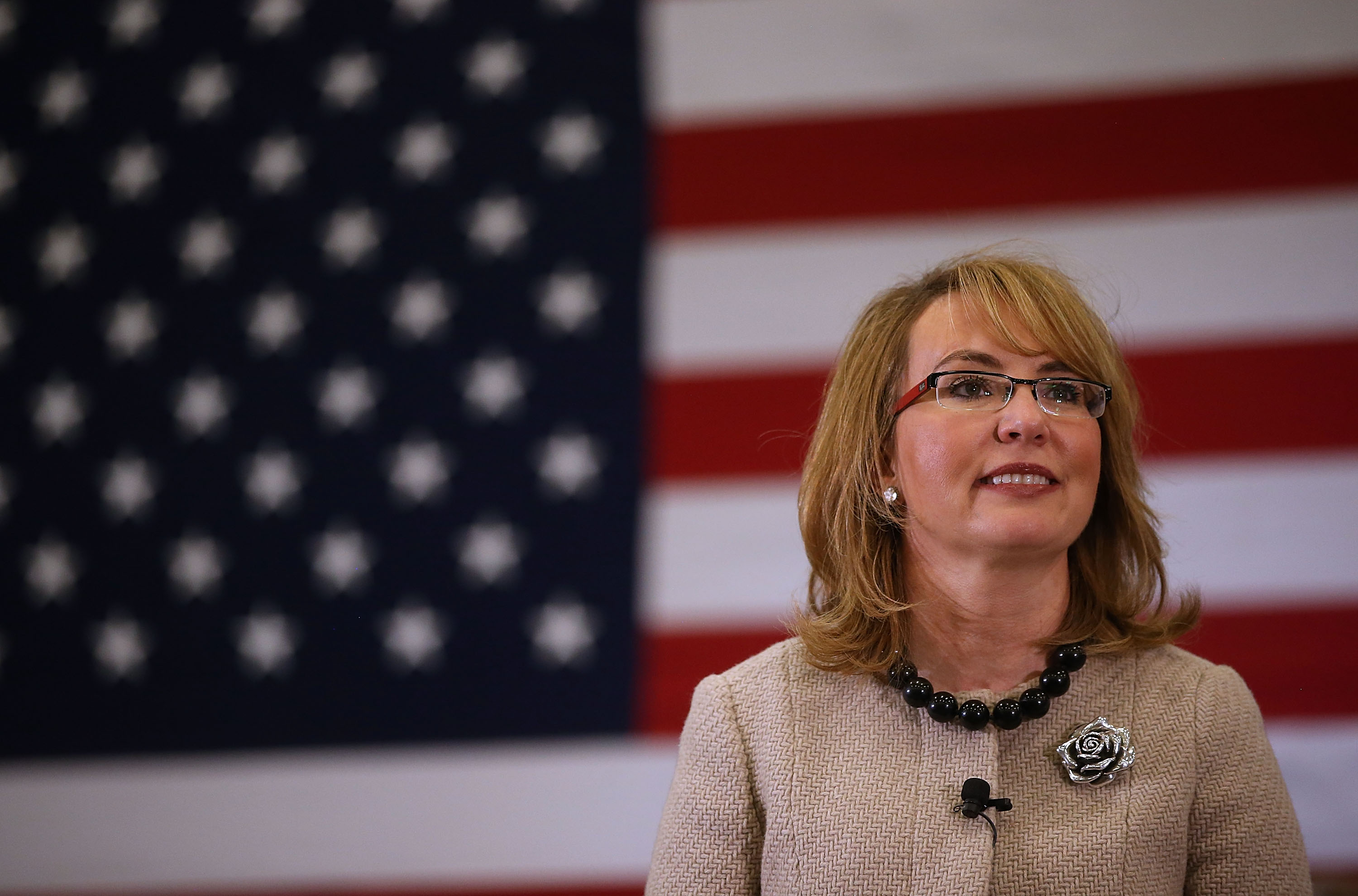 Former Rep. Gabrielle Giffords (D-AZ) looks on as democratic presidential candidate  Hillary Clinton speaks during a  get out the vote  event on Feb. 2, in Hampton, New Hampshire.