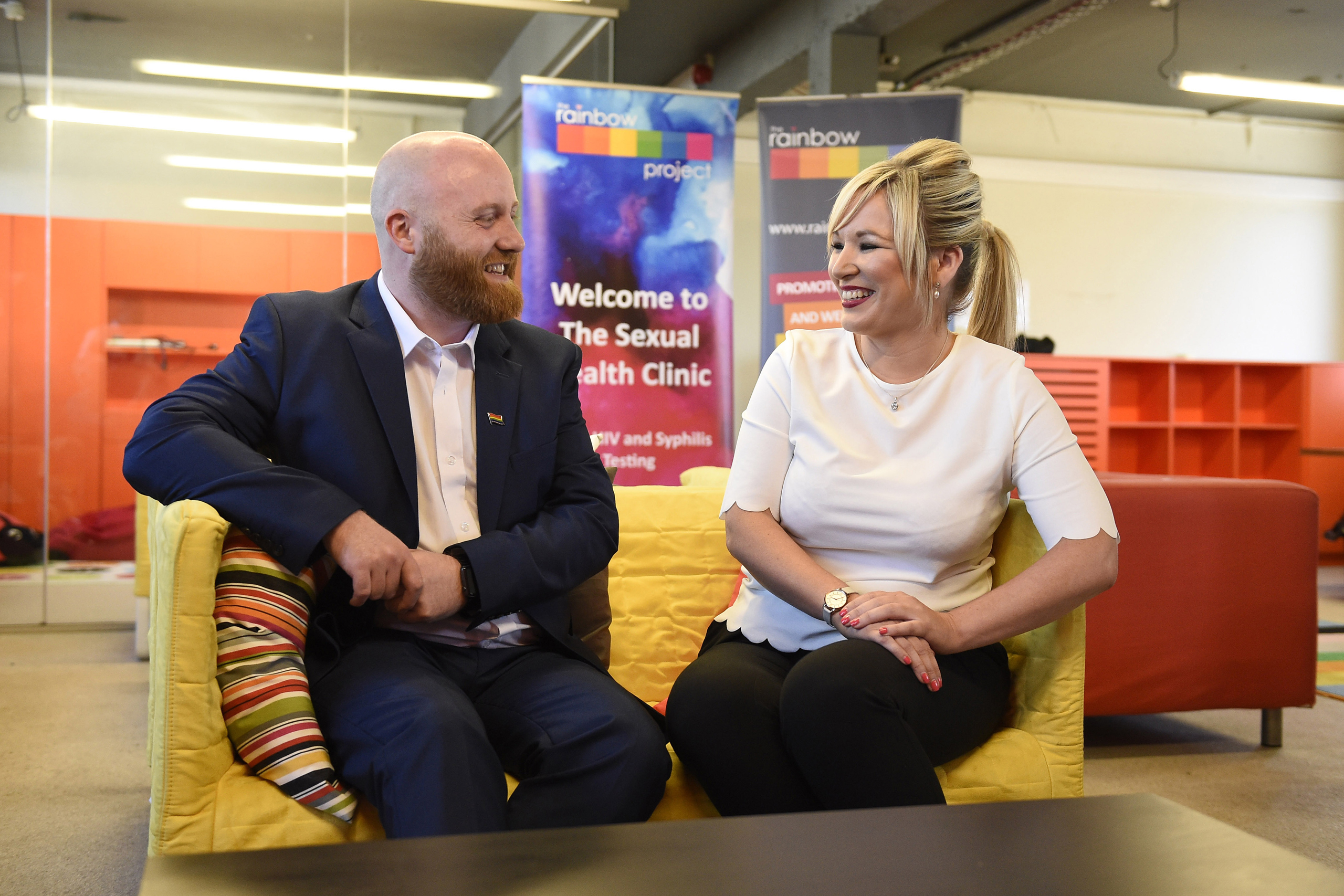 Health Minister Michelle O'Neill with John O'Doherty from The Rainbow Project which supports the LGBT community, at the organization's offices in Belfast, June 2, 2016.