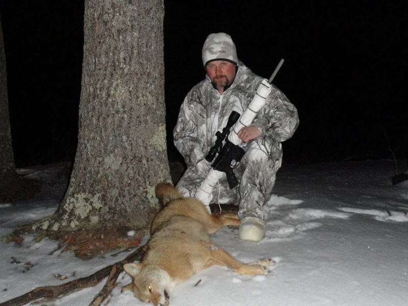George Sodergren poses with a coyote he killed with his AR-15 in Maine.