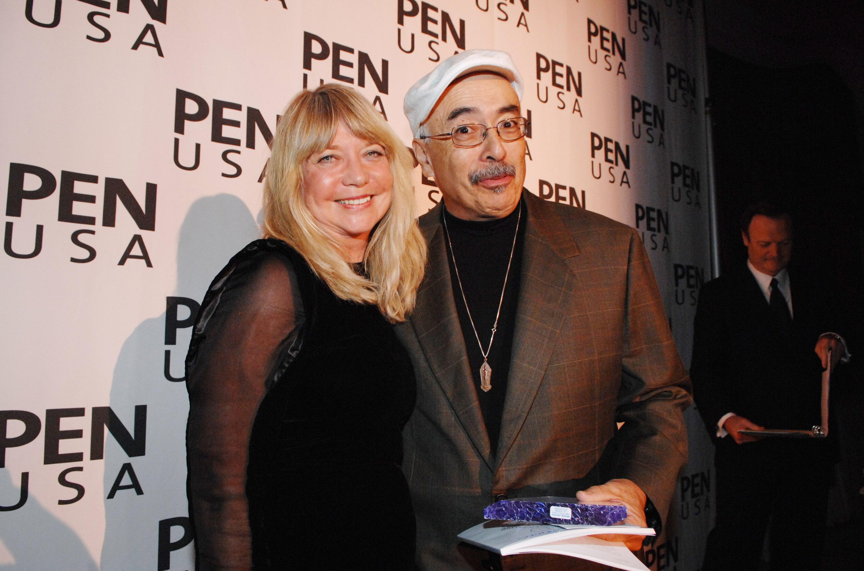 Carol Muske-Dukes (L) presents the Poetry Award to Juan Felipe Herrera (R) at the 18th Annual PEN USA Literary Festival in Los Angeles on Dec. 3, 2008.