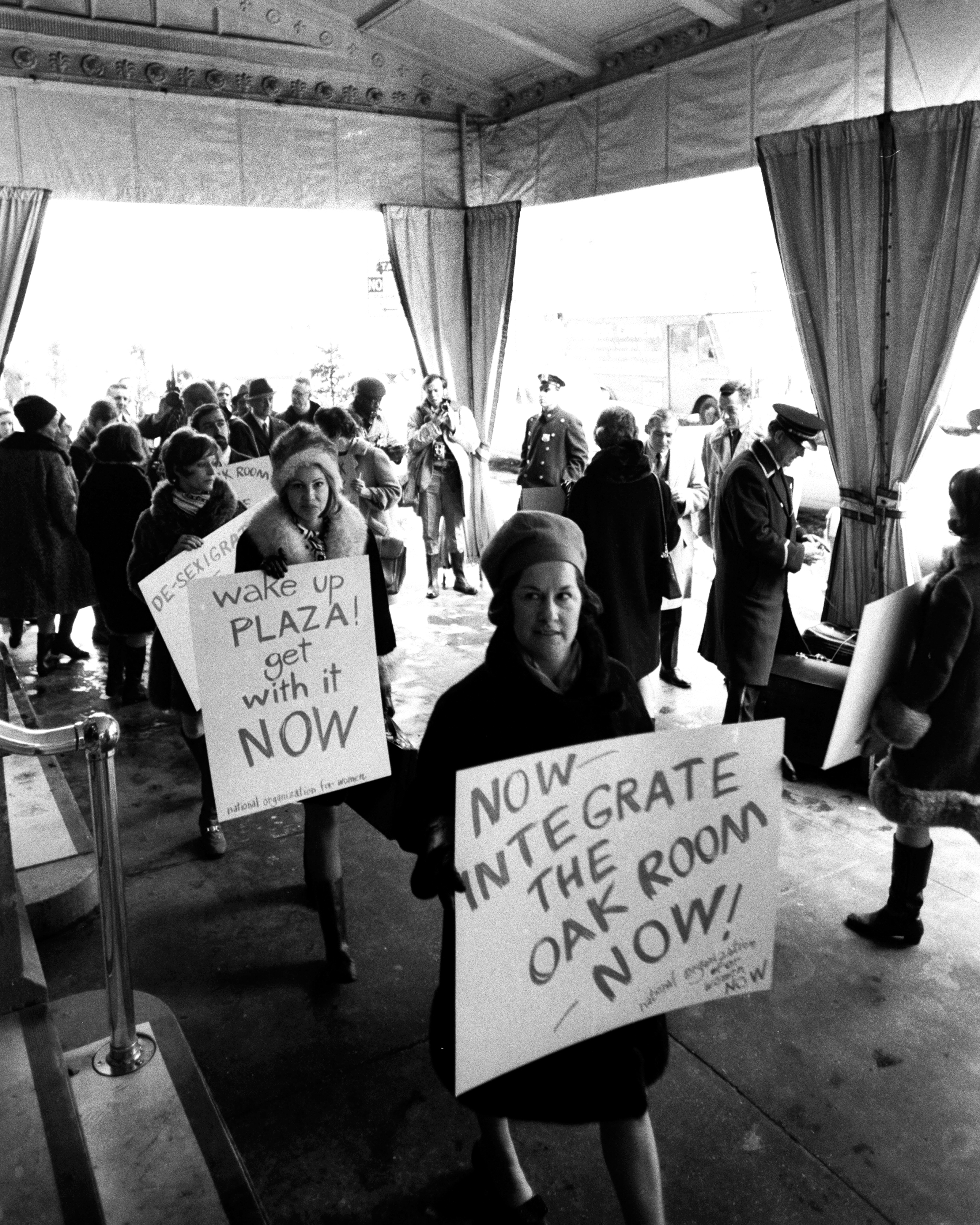 The National Organization for Women, upset by the  men only  policy of the Hotel Plaza, demonstrate outside.