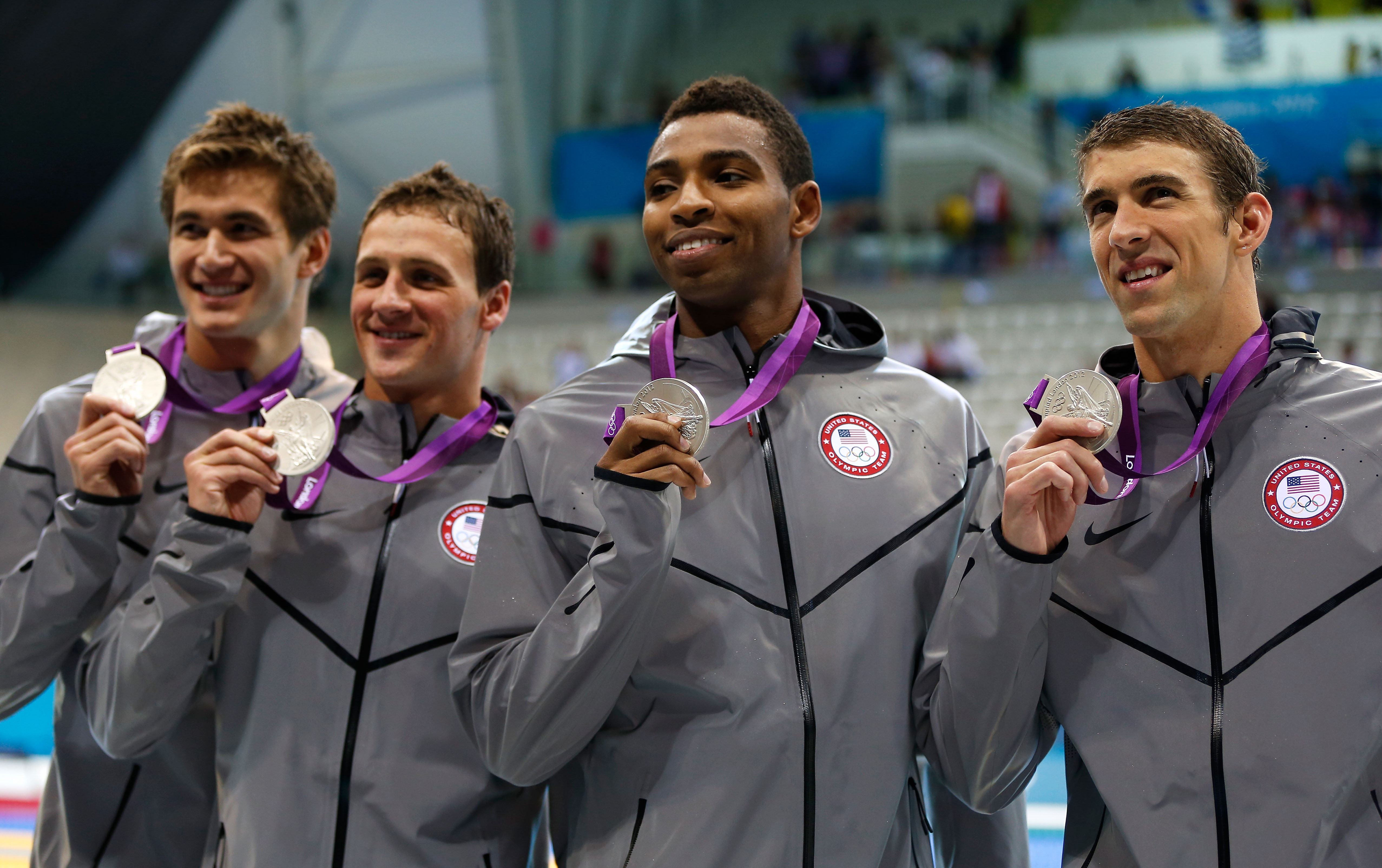 Cullen Jones poses with team-mates, from left, Adrian Nathan, Ryan Lochte,  and Michael Phelps with the silver medals won for the Men's 4 x 100m Freestyle Relay final during the London 2012 Olympic Games