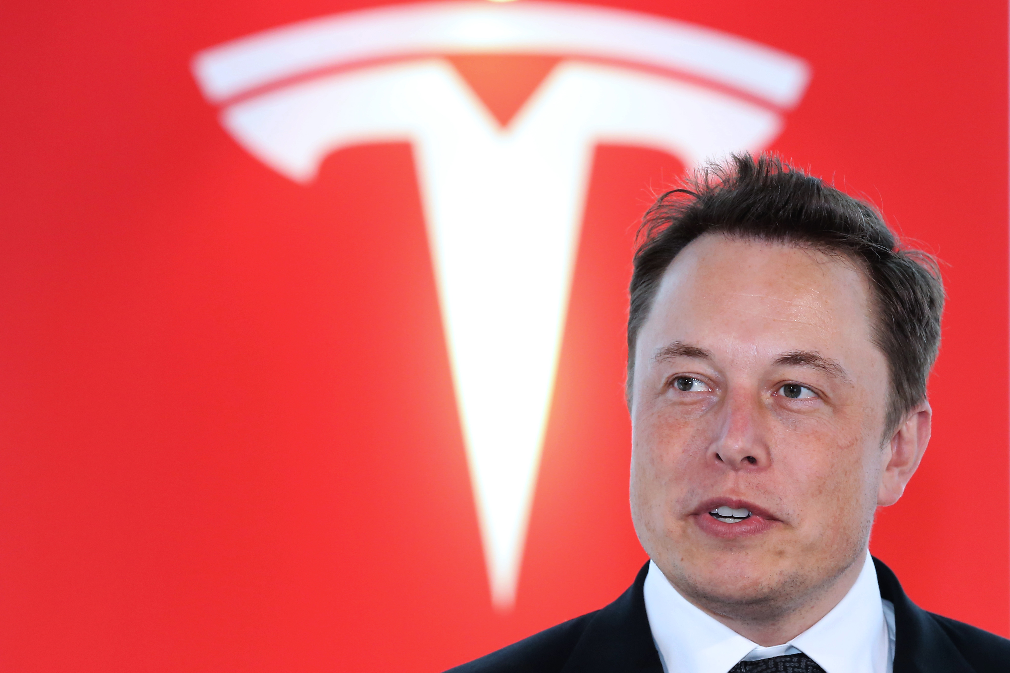 Elon Musk, co-founder and chief executive officer of Tesla Motors Inc., attends a key delivery ceremony of the company's premium electric sedan Model S vehicles to customers in Tokyo, Japan, on Monday, Sept. 8, 2014.