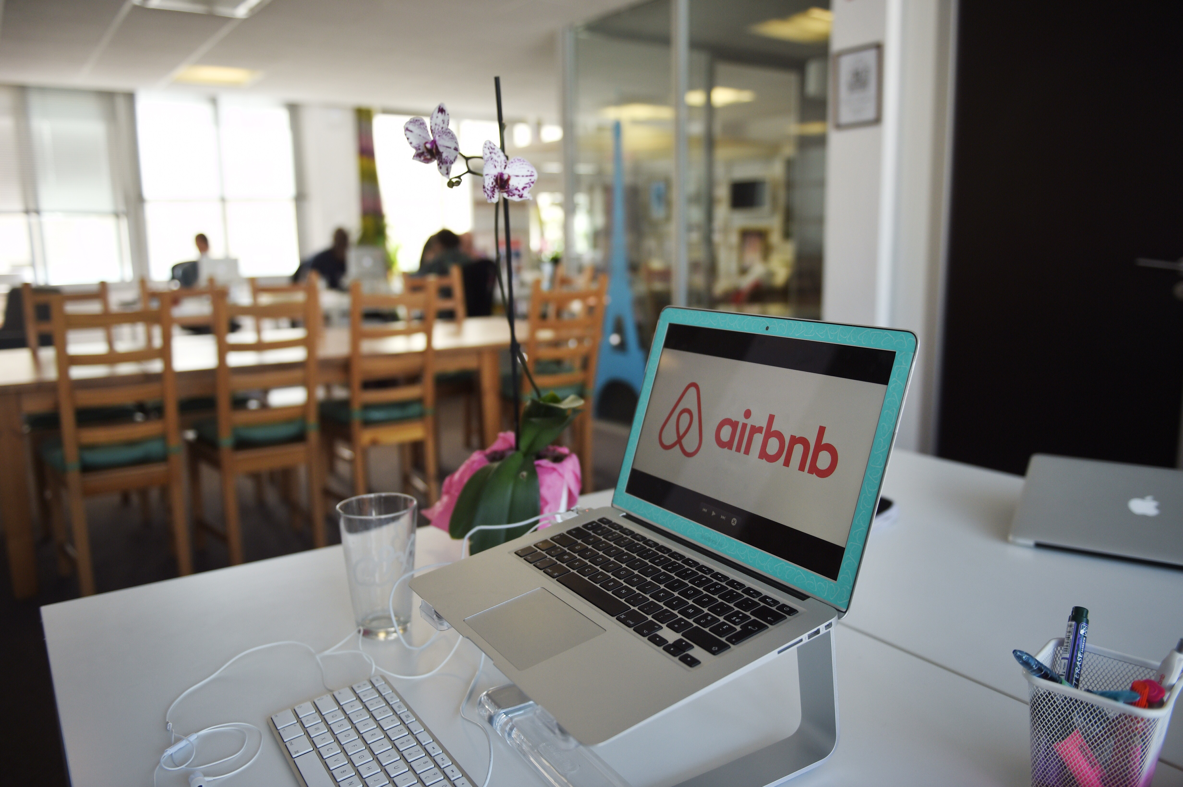 Airbnb logo displayed on a computer screen in the Airbnb offices in Paris on April 21, 2015
