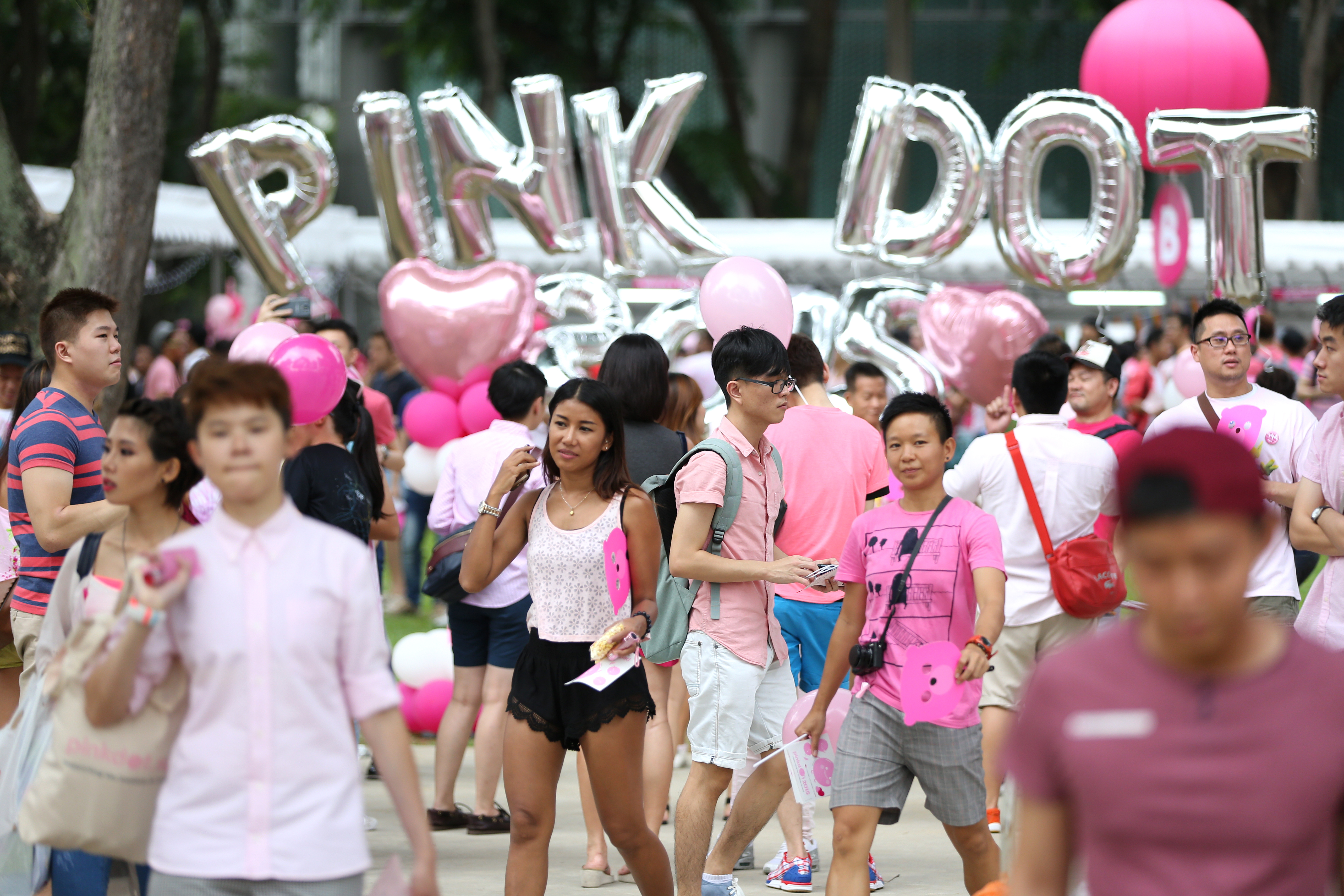 People dressed in various shades of pink attend Pink Dot SG on June 13, 2015 in Singapore