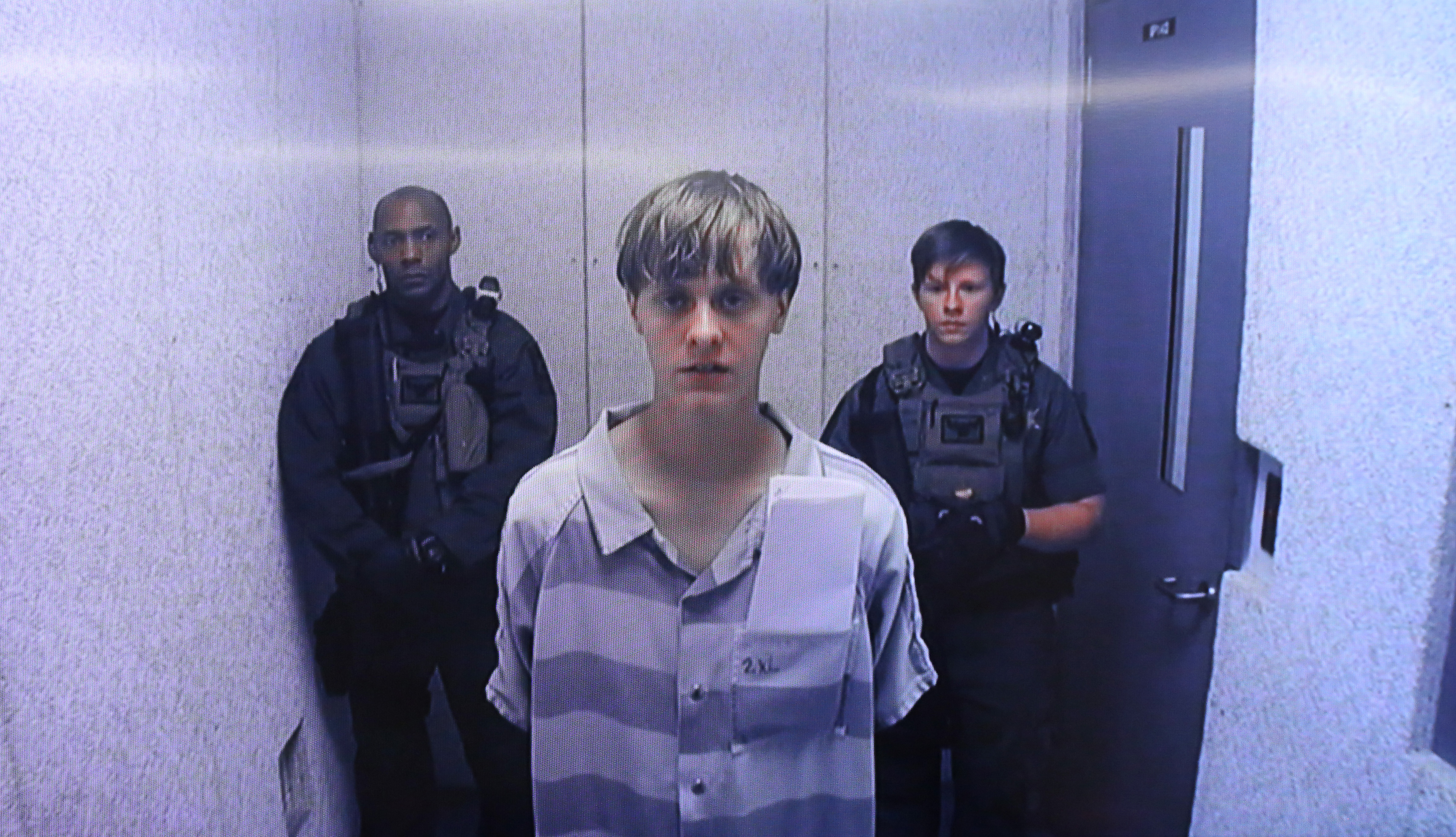 An image from the video uplink from the detention center to the courtroom, Dylann Roof appears at Centralized Bond Hearing Court in North Charleston, South Carolina, on June 19, 2015.