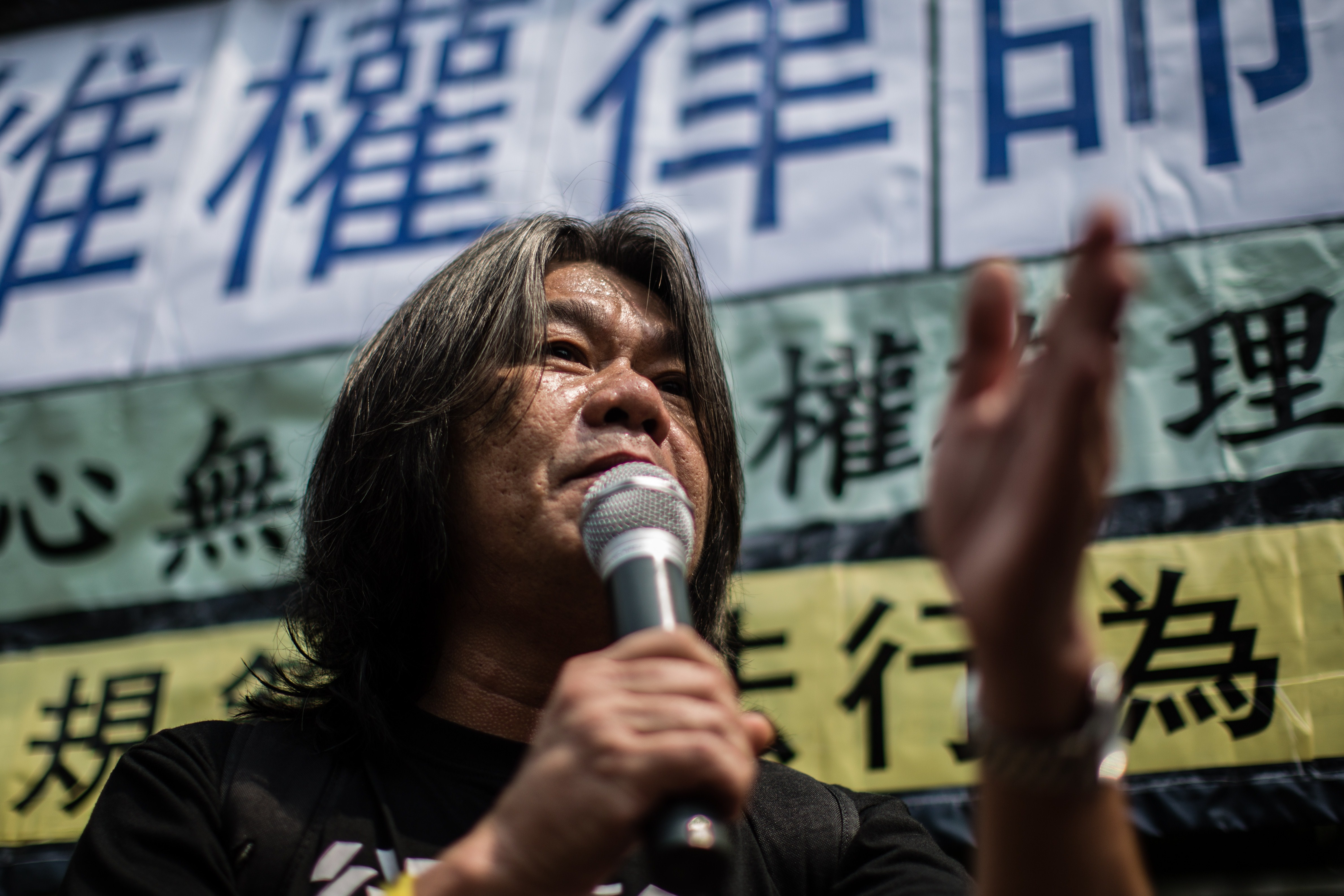 Hong Kong legislator Leung Kwok-hung, known as Long Hair, of the League of Social Democrats speaks during a protest in Hong Kong on July 12, 2015