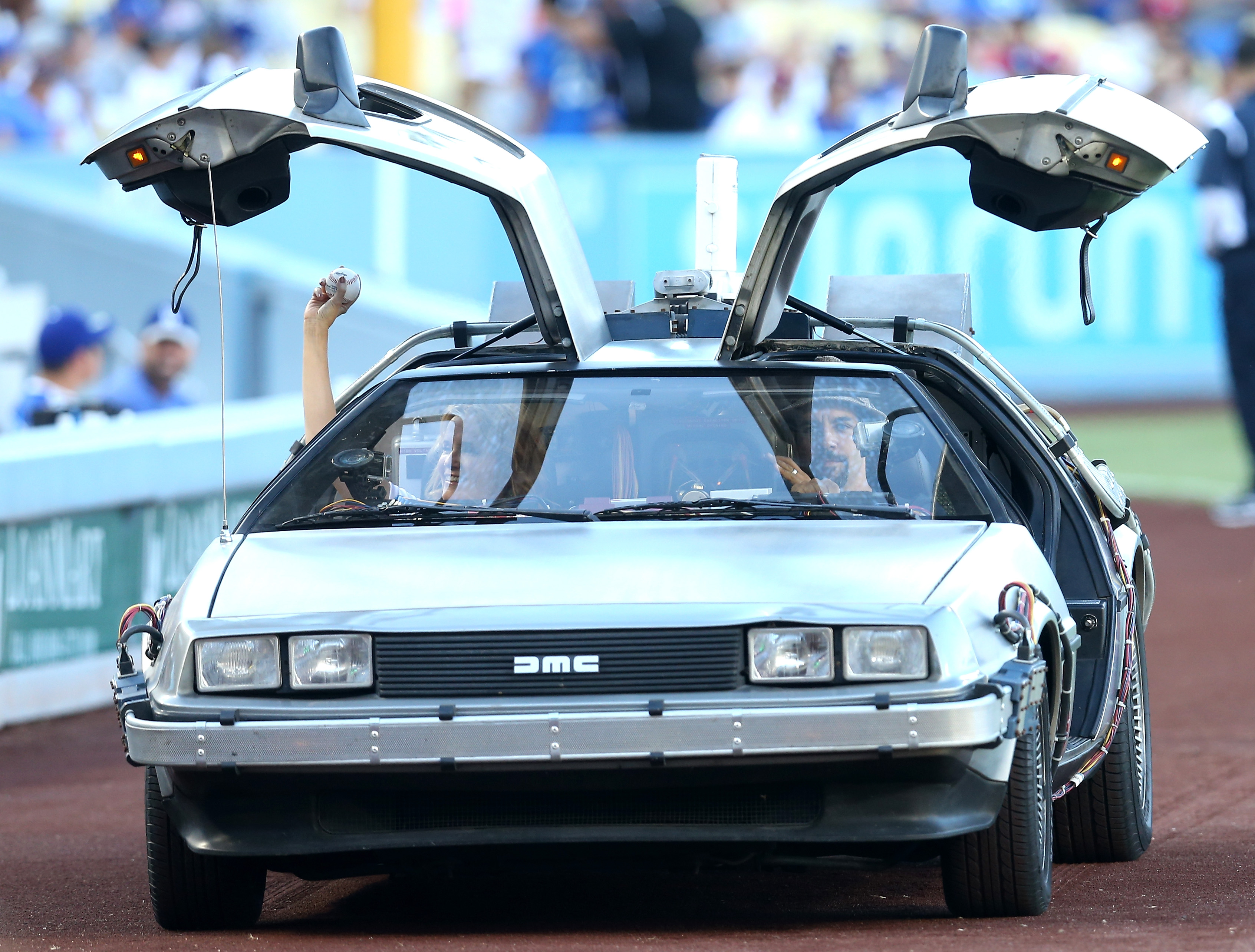 Actress Lea Thompson arrives in a DeLorean to throw out the first pitch before the game between the Cincinnati Reds and the Los Angeles Dodgers at Dodger Stadium on August 15, 2015 in Los Angeles, California, ahead of the after game showing of Back to Future on the stadium video boards.