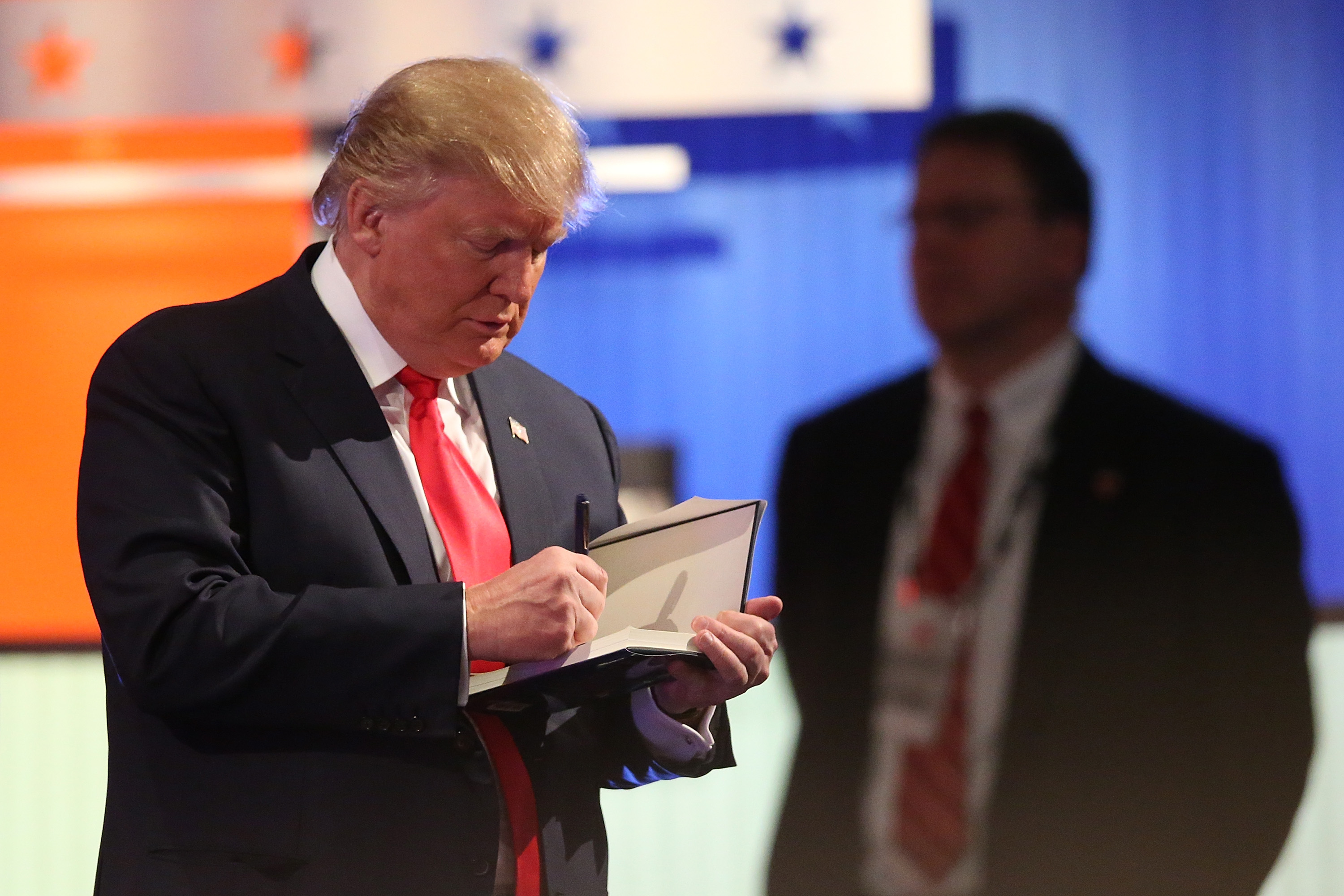 Donald Trump writing in a book in North Charleston, South Carolina on January 14, 2016.