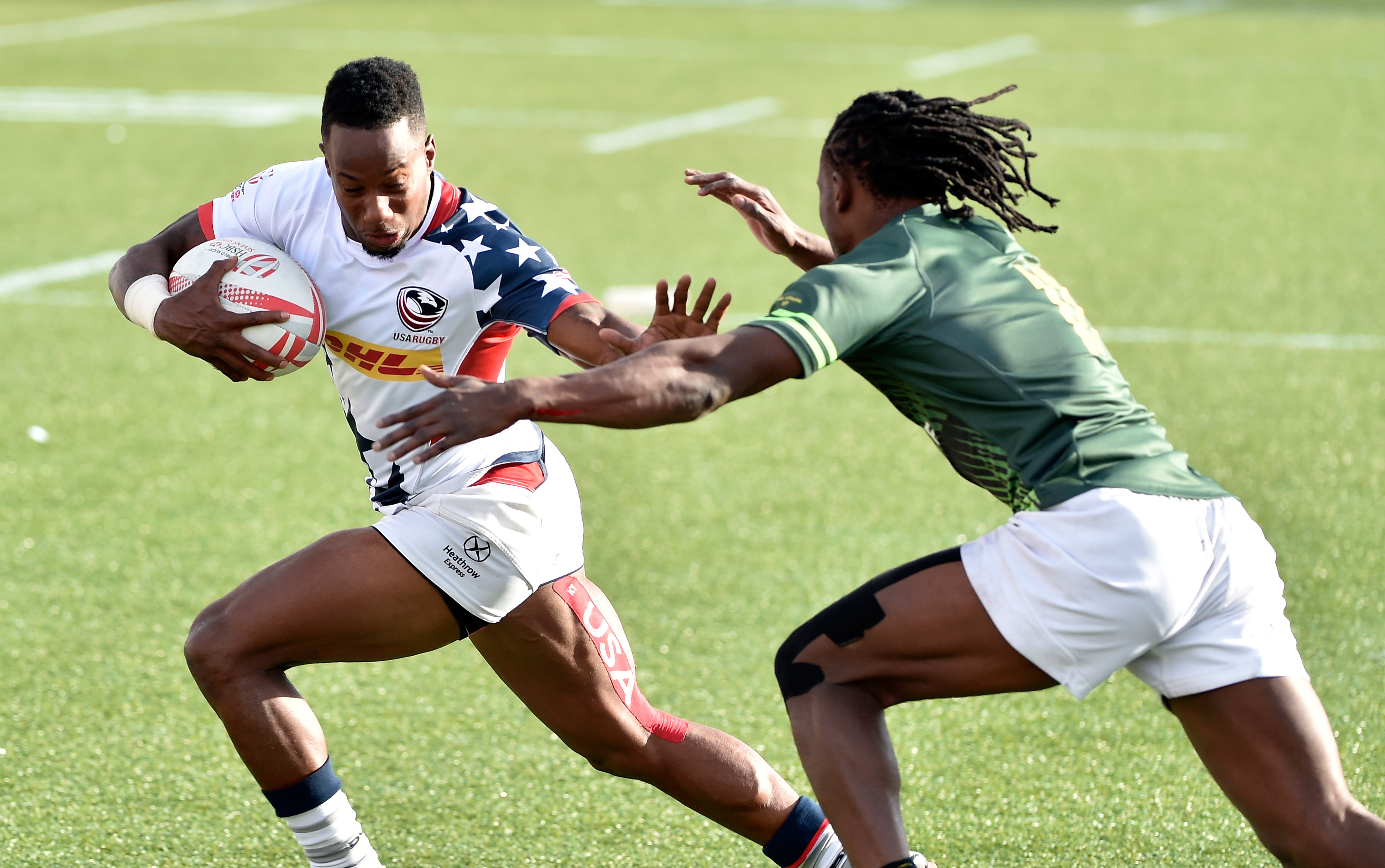 Carlin Isles (L) of the United States holds offs Seabelo Senatla of South Africa during the USA Sevens Rugby tournament at Sam Boyd Stadium on March 6, 2016 in Las Vegas, Nevada.