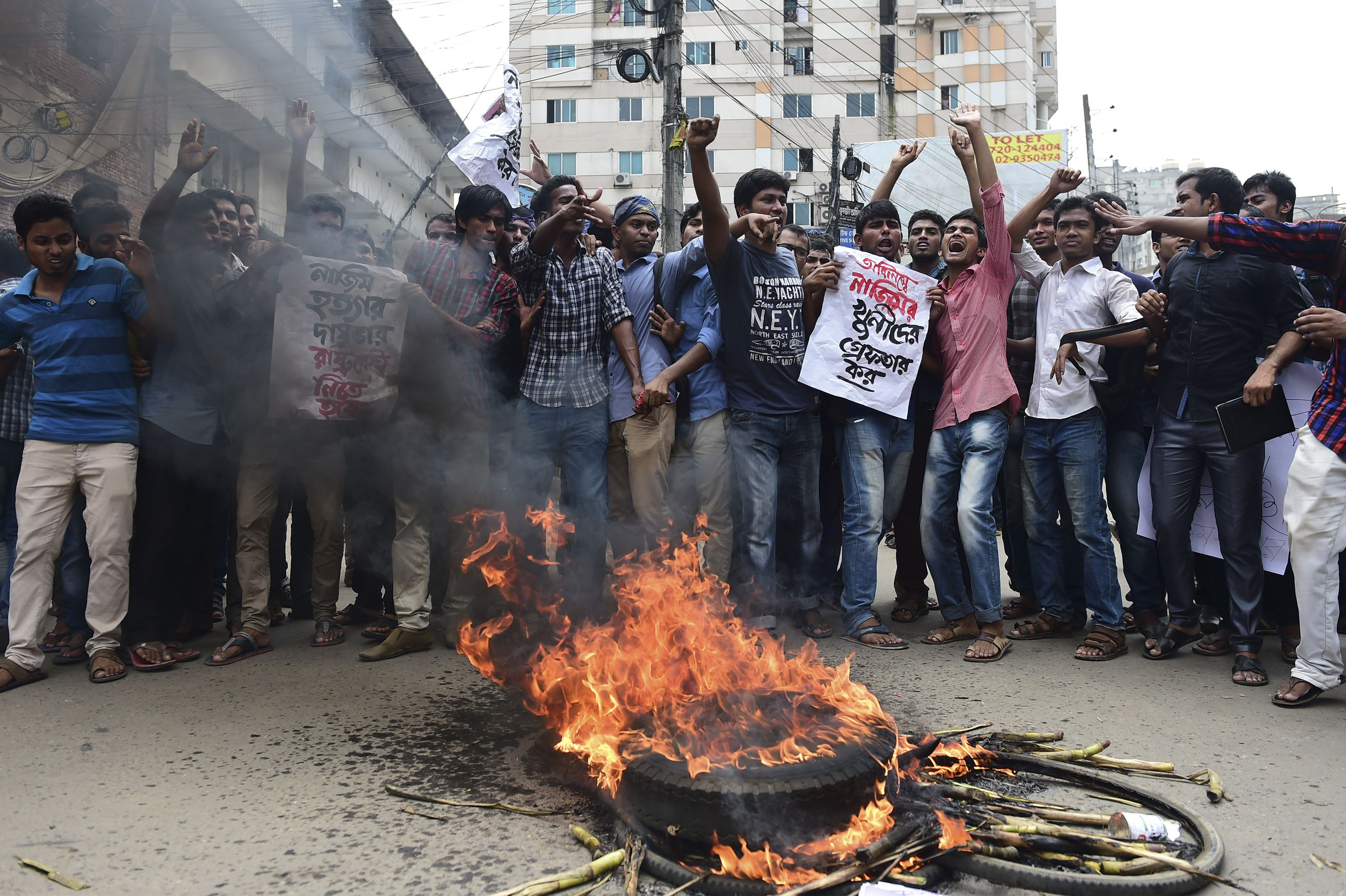 Bangladeshi students block the road and stage a protest following the murder of a law student who posted against Islamism on Facebook and was hacked to death by four assailants the night before, in Dhaka on April 7, 2016.