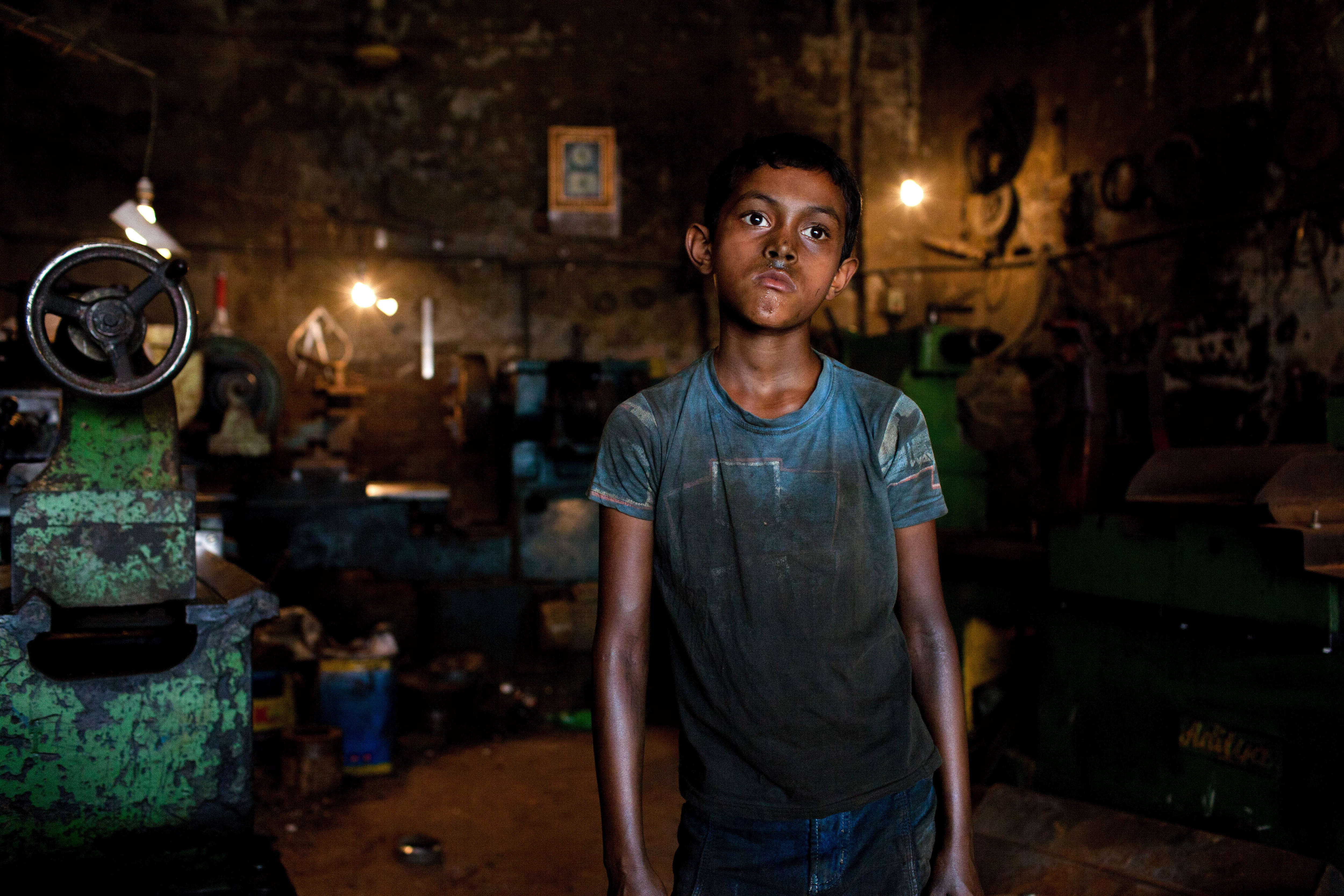 Rakib works in a parts-making shop in Dhaka, Bangladesh, on June 17, 2015. Children in Bangladesh are often employed to do hard manual labor