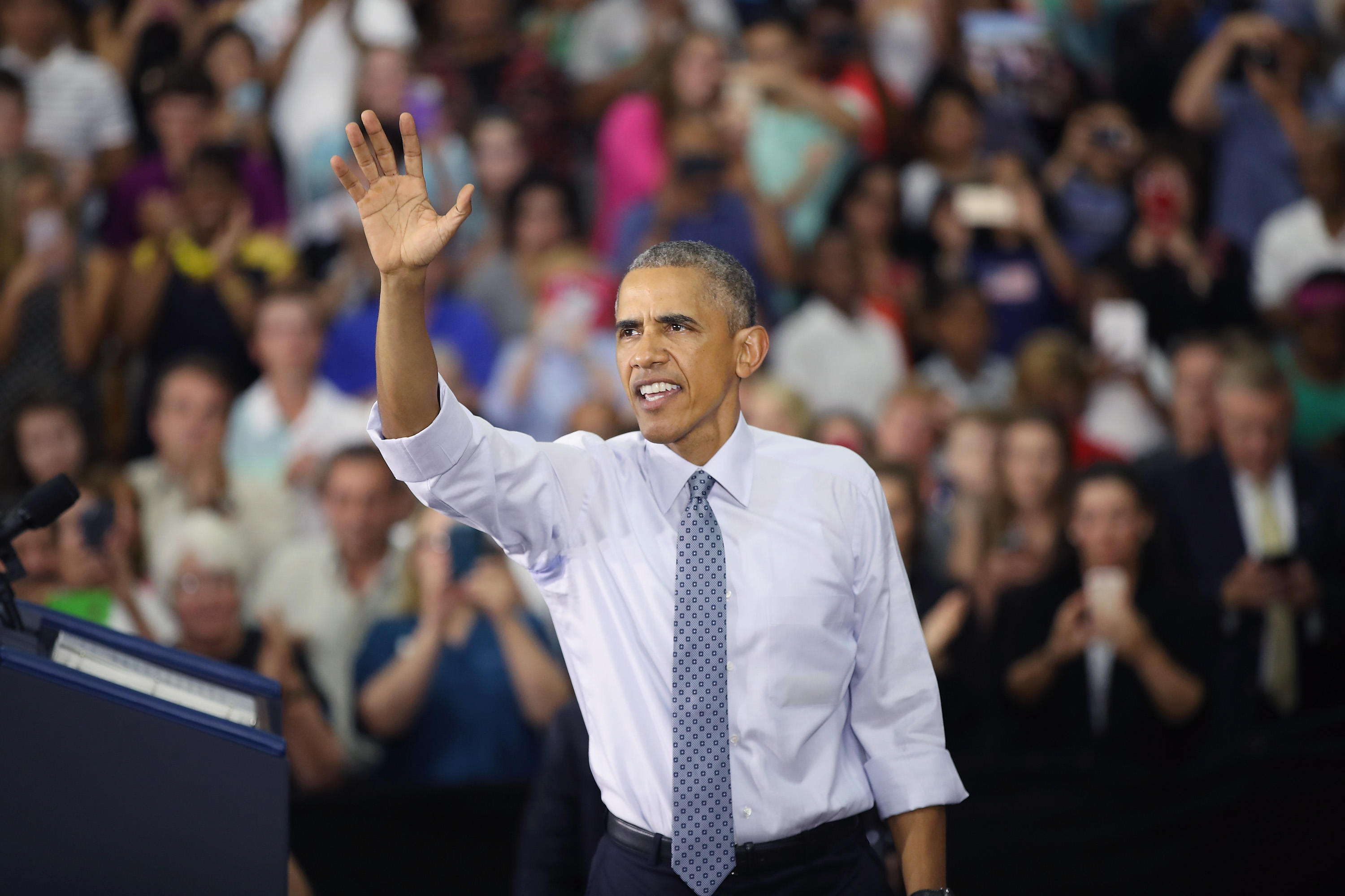 President Barack Obama waves to the crowd at Concord Community High School as he leaves after speaking on June 1, 2016 in Elkhart, Indiana. Obama returned to the school, which he visited more than seven years ago, to highlight economic progress made during his administration. Scott Olson—Getty Images