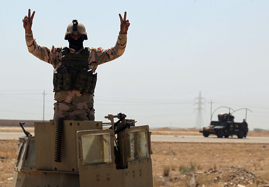 A member of the Iraqi government forces gestures as they take a position outside al-Shuhada neighborhood, south of Fallujah, during an operation to regain control of the area from the Islamic State group on June 3, 2016.                     Iraqi forces on May 22-23 launched a vast offensive aimed at retaking the IS bastion of Fallujah, a city only 50 kilometres (30 miles) west of Baghdad that was the first to fall out of government control in 2014. / AFP / AHMAD AL-RUBAYE        (Photo credit should read AHMAD AL-RUBAYE/AFP/Getty Images)