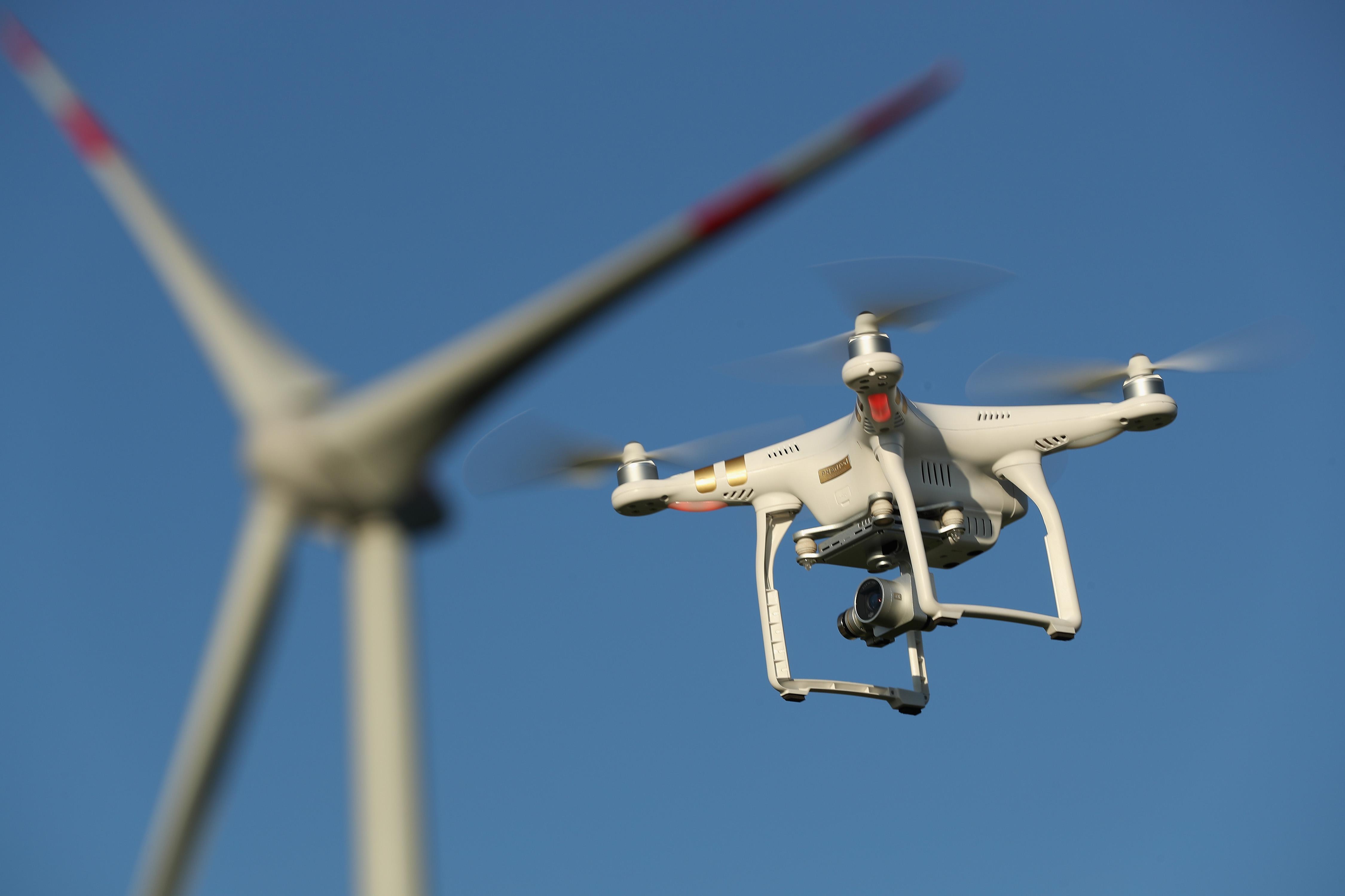 The photographer's DJI Phantom 3 Pro multirotor drone flies near a wind farm on June 8, 2016 near Brueck, Germany. Sean Gallup—Getty Images