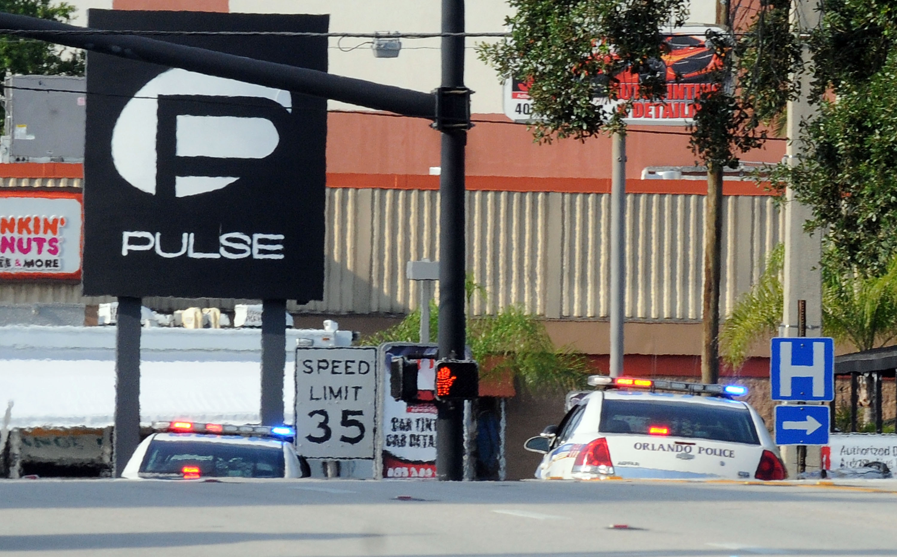 Orlando police officers seen outside of Pulse nightclub after a fatal shooting and hostage situation on June 12, 2016 in Orlando, Florida. Gerardo Mora—Getty Images