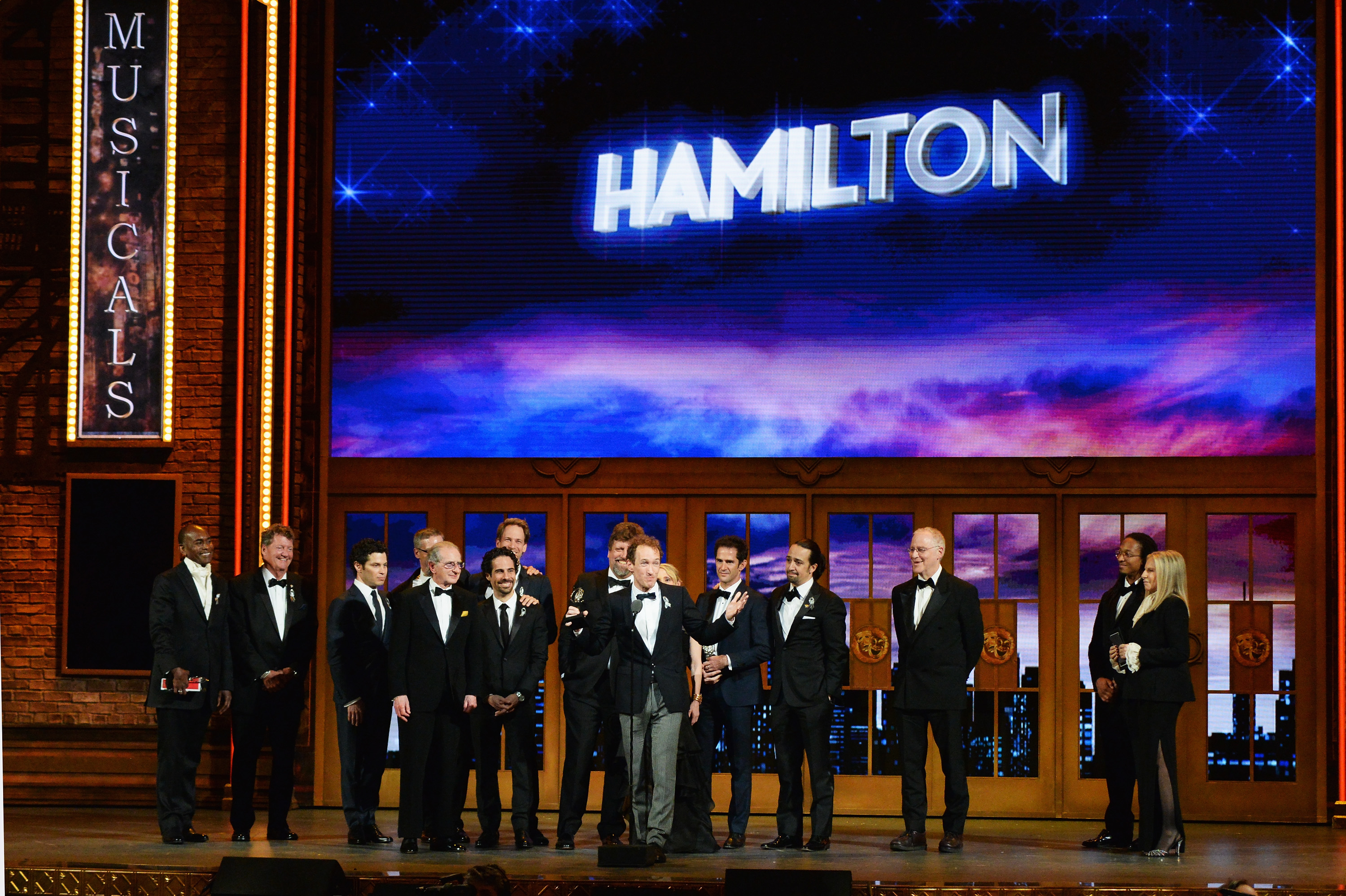 Producer Jeffrey Seller (C) accepts the Tony award for Best Musical for  Hamilton  onstage with his cast and creative team during the 70th Annual Tony Awards at The Beacon Theatre on June 12, 2016 in New York City.
