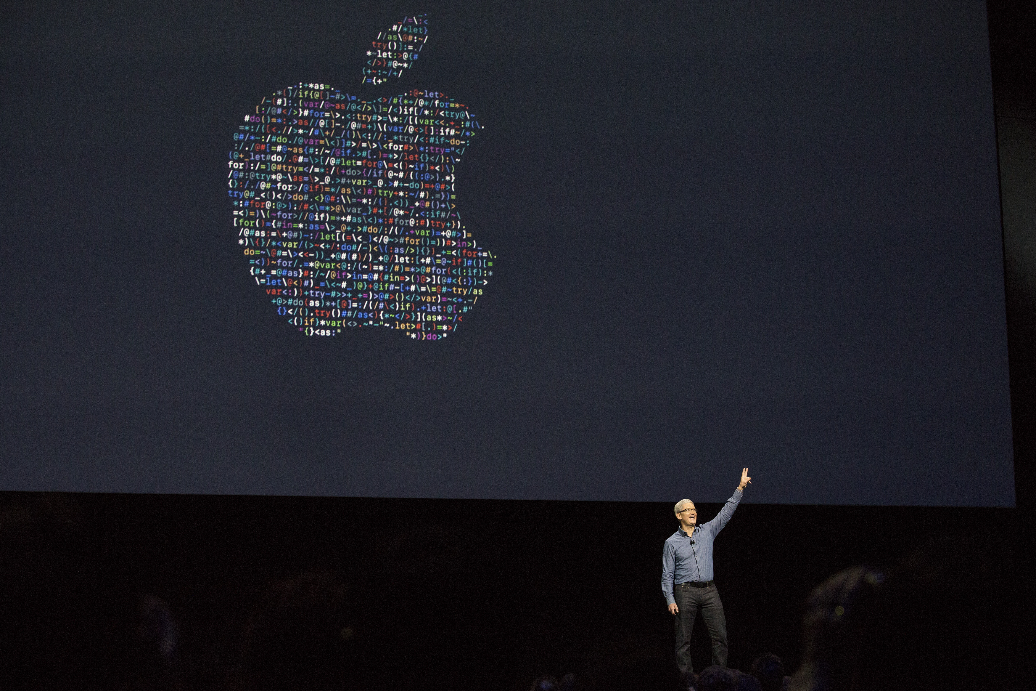 Apple CEO Tim Cook waves good bye after speaking at an Apple event at the Worldwide Developer's Conference on June 13, 2016 in San Francisco, California.