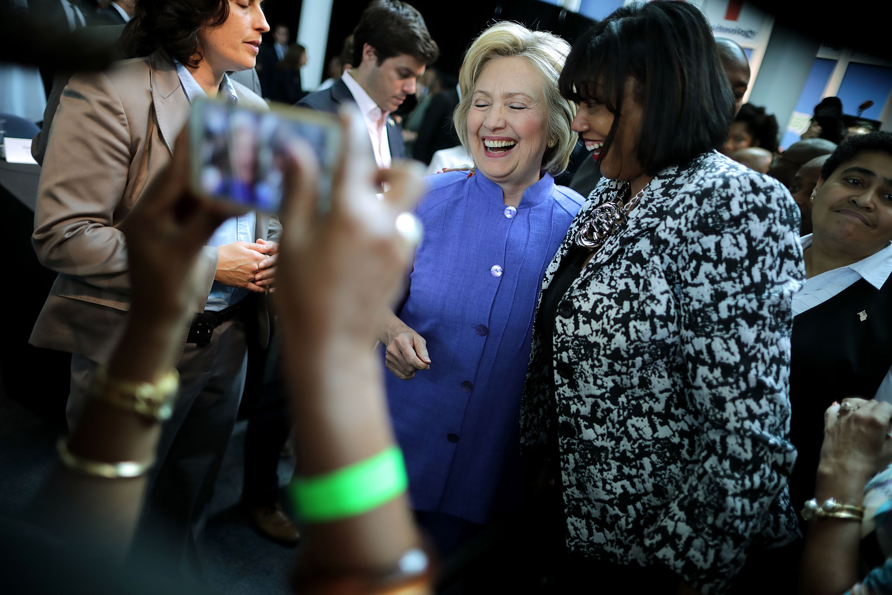 Democratic presidential candidate Hillary Clinton poses for photographs with supporters after participating in a round table conversation on national security at the Virginia Air and Space Center June 15, 2016 in Hampton, Virginia. Following the nation's final presidential primary in the District of Columbia on Tuesday, it is clear that Clinton has won enough votes to be her party's standard bearer in this fall's election.
