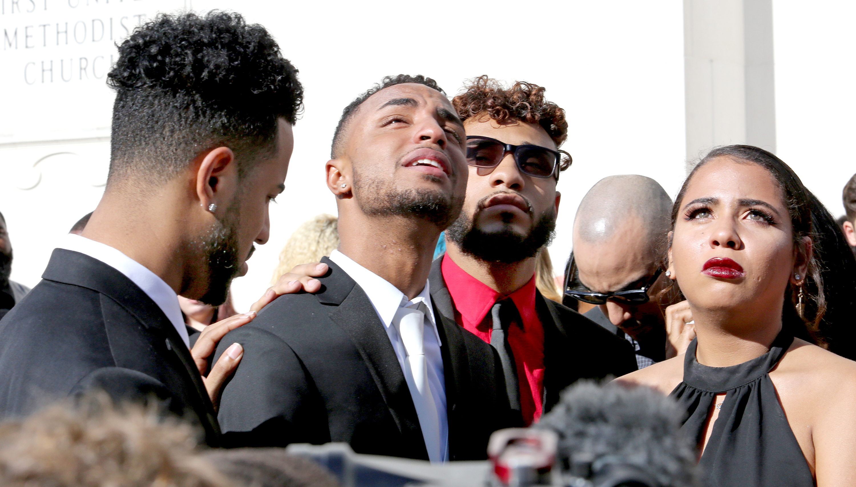 Robert Presley, Isaiah Henderson, an unidentified family member and Tatiana Harris during the funeral for their mother Brenda Lee Marquez McCool in Orlando, Fla., on June 20, 2016