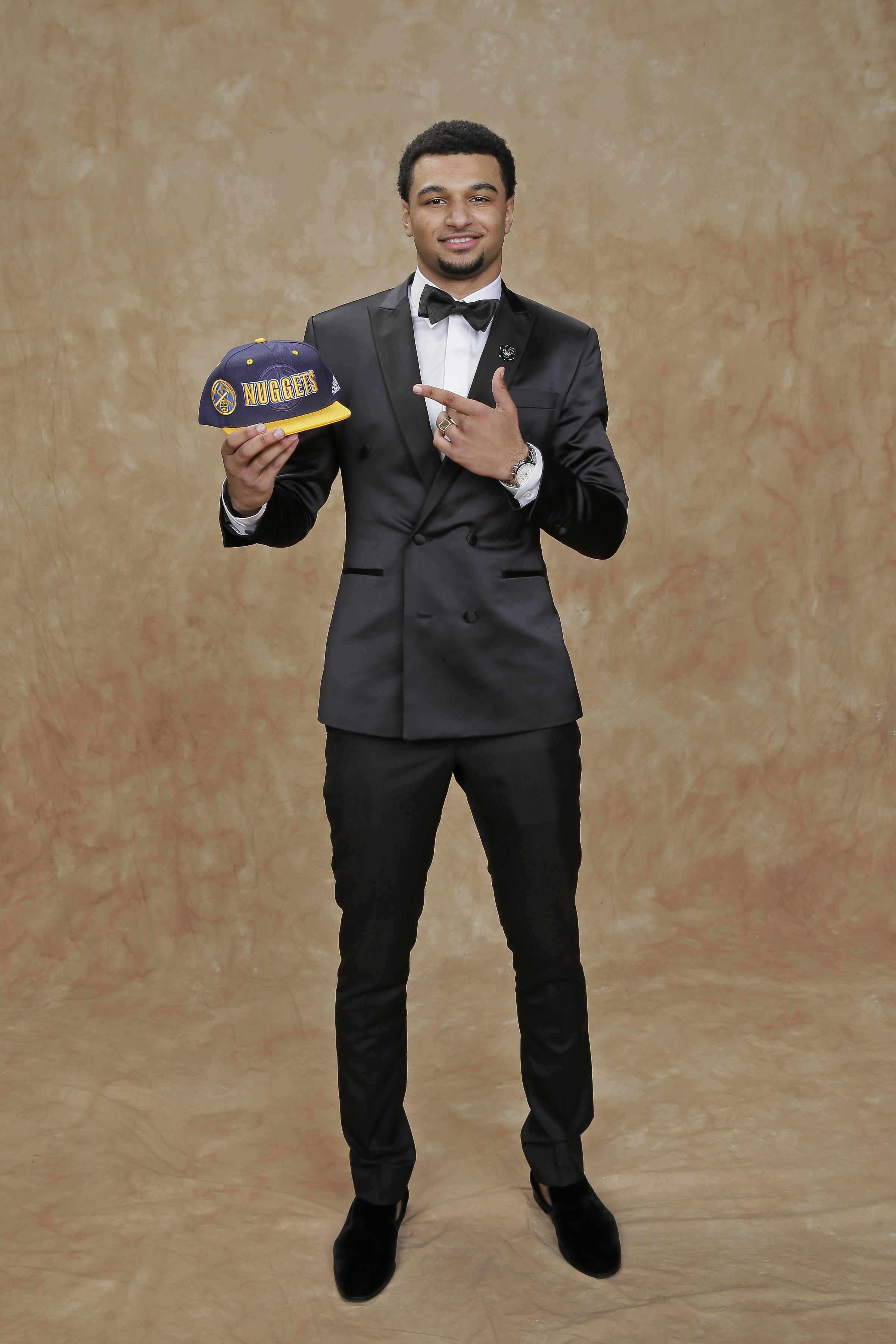 Jamal Murray updated his classic tuxedo look by opting for a sleek satin material.