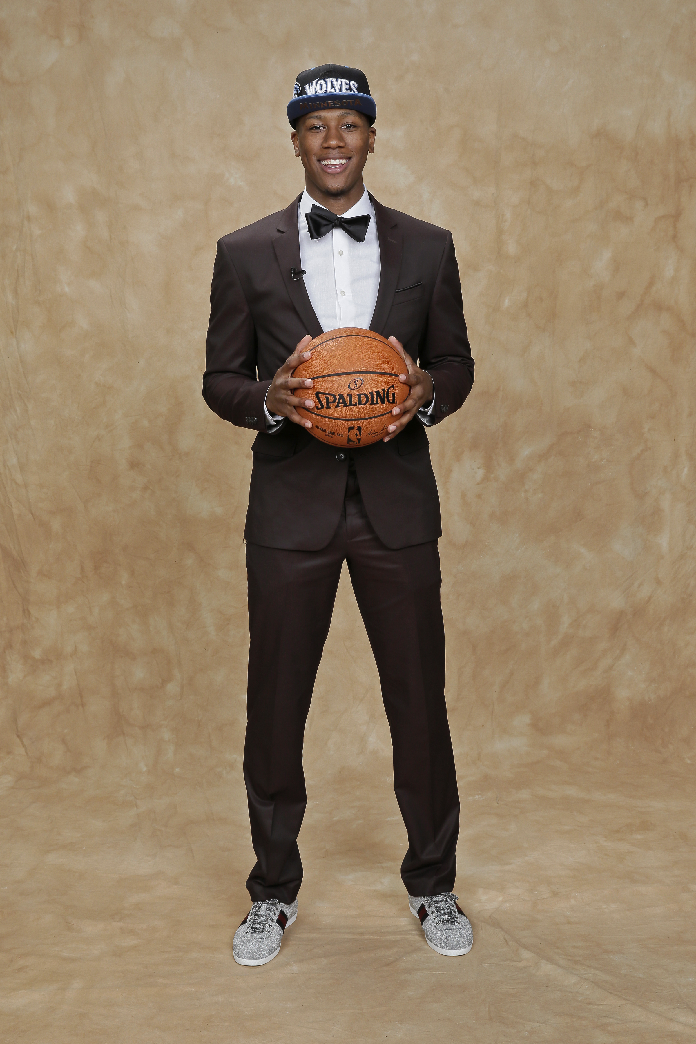 Kris Dunn proved that the best style can come from an appreciation of a high-low aesthetic. Case in point? His dapper JC Penney suit paired with a pair of sparkling silver Gucci sneakers.