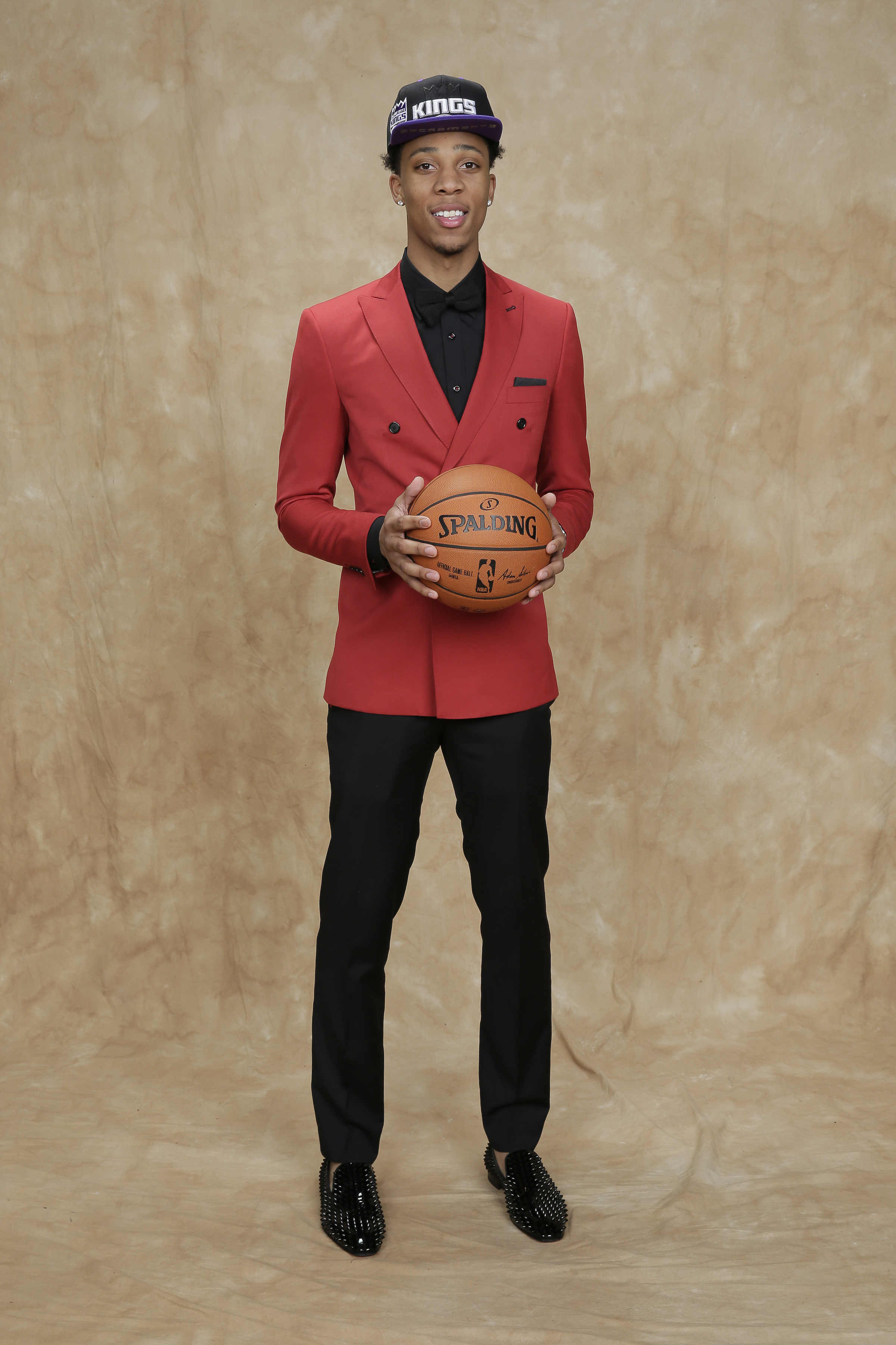 Malachi Richardson wore the undisputed color of the draft night, red, with an edgy twist — a double breasted suit jacket over an all-black ensemble.