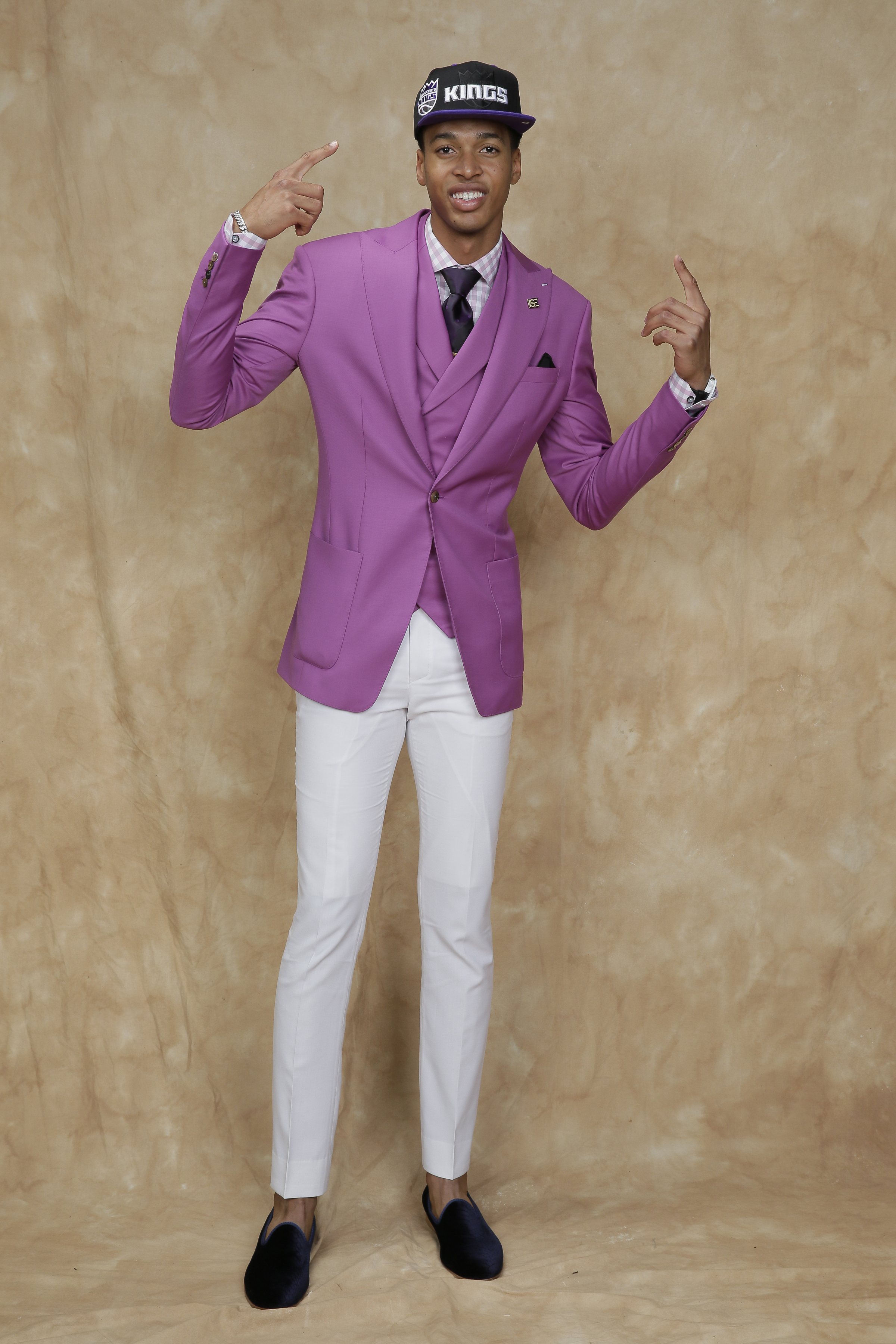 Skal Labissiere bucked convention and sported a pink jacket and vest with slim white pants and velvet smoking slippers for a suave, preppy look.