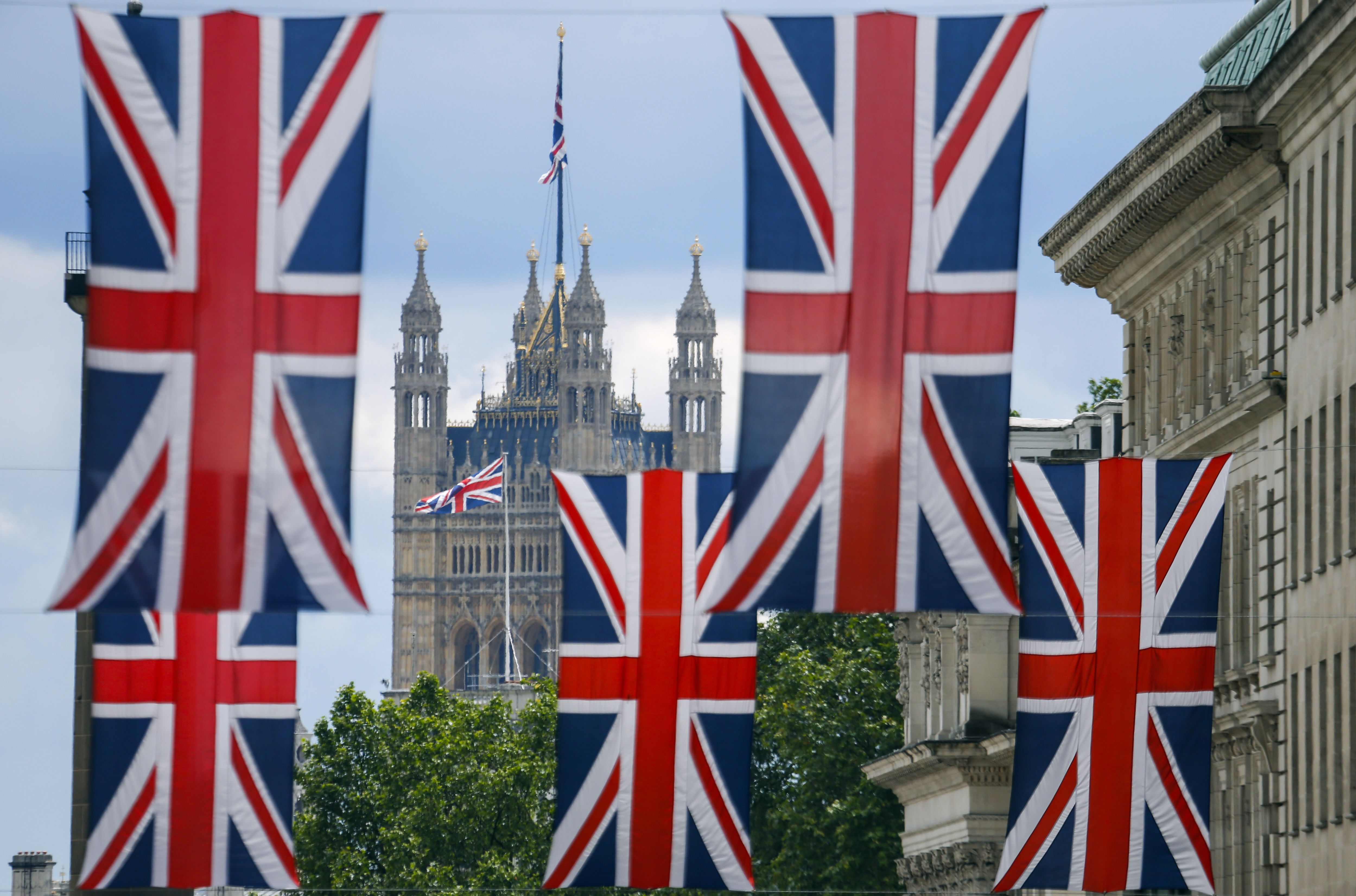 Union flag banners hang across a street near the Houses of Parliament in central London on June 25, 2016