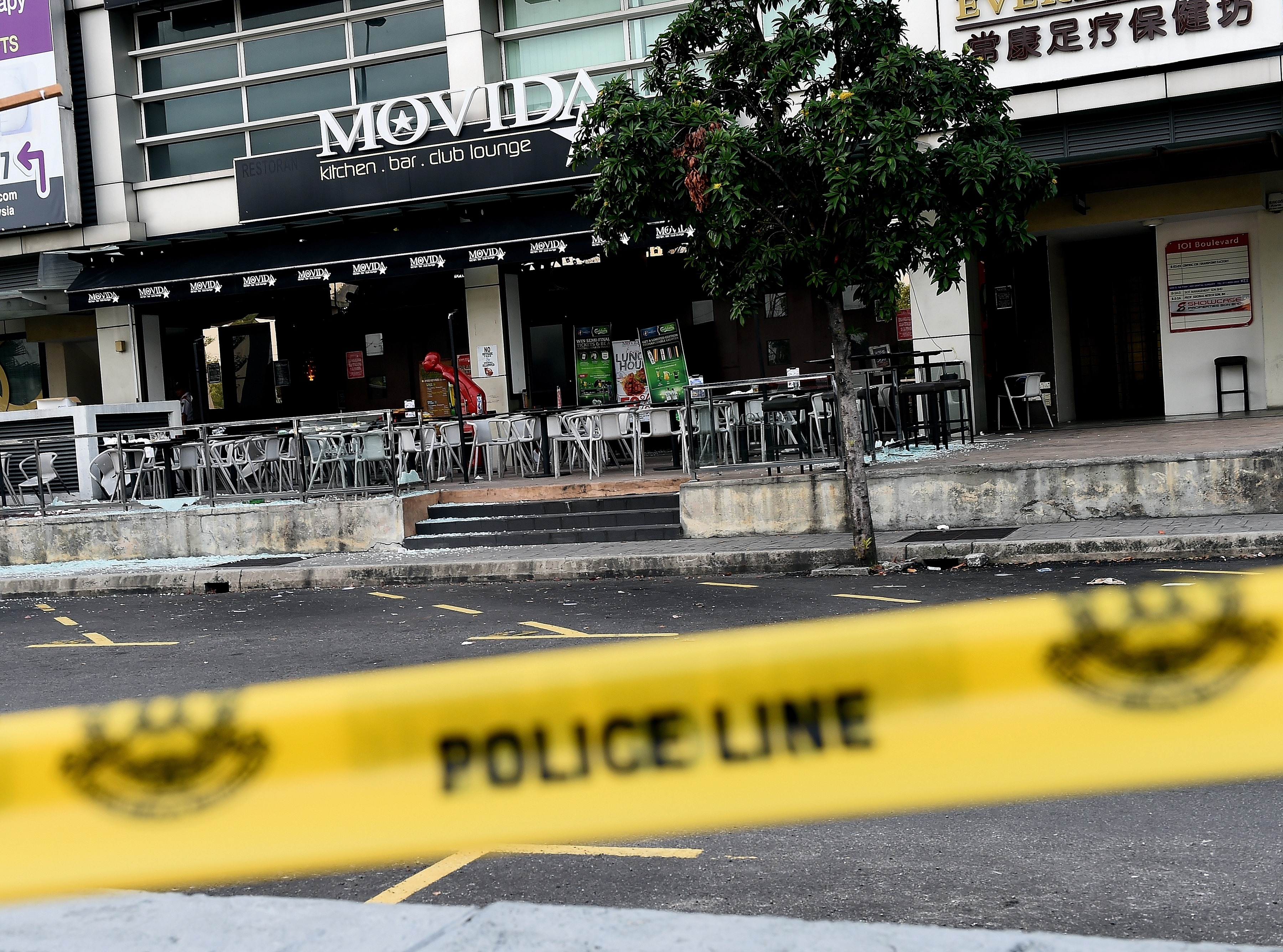 A general view of the site of a grenade attack at a restaurant in Puchong, outside of Kuala Lumpur, on June 28, 2016