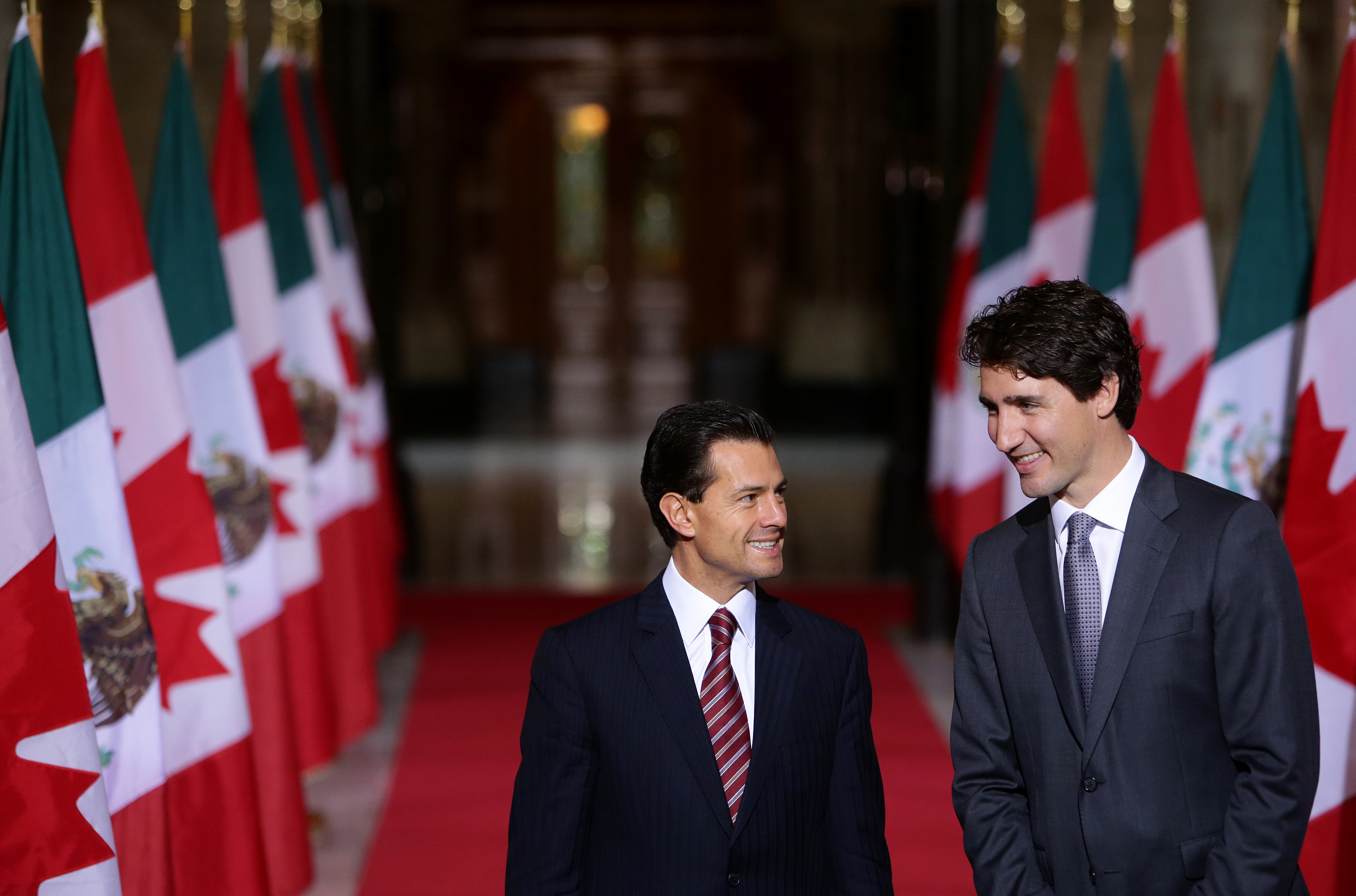 Justin Trudeau, Canada's prime minister, right, smiles with Enrique Pena Nieto, Mexico's president, in the Hall of Honour at Parliament Hill ahead of the North American Leaders Summit (NALS) in Ottawa, Ontario, Canada, on June 28, 2016.
