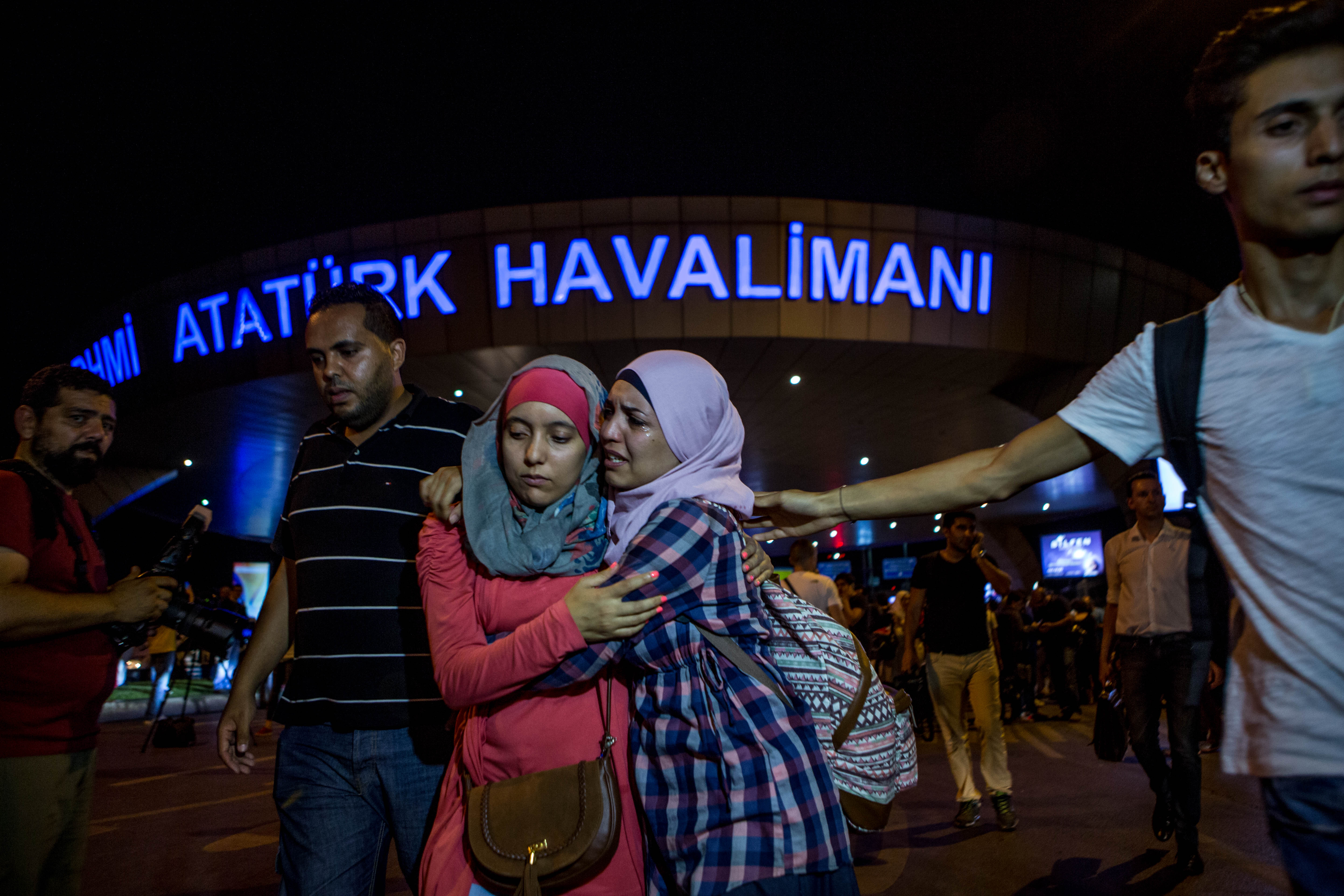 Passengers leave Istanbul Ataturk Airport, Turkey's largest airport, after a suicide-bomb attack in the early hours of in Istanbul on June 29, 2016.