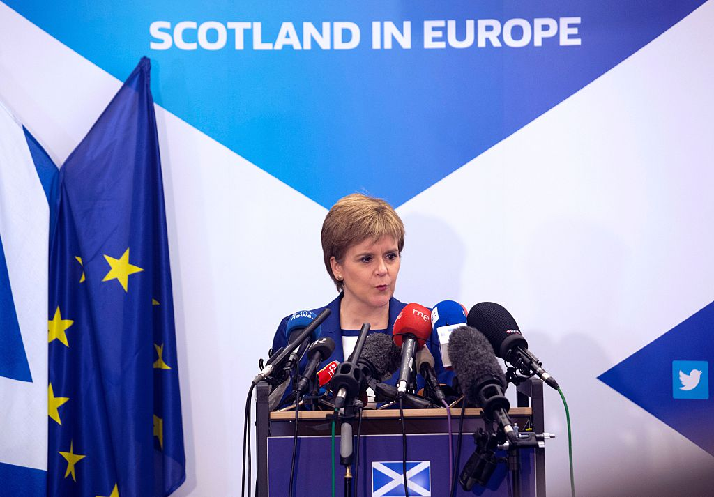 Scotland's First Minister Nicola Sturgeon delivers a speech during a media conference at the Scotland House in Brussels as she is on a one day visit to meet with EU officials, on June 29, 2016.                     Scotland's First Minister Nicola Sturgeon said she was  heartened  by her talks with EU officials today but said there was no  automatic easy path  to protecting her country's status in the EU after Brexit. / AFP / POOL / Geoffroy Van der Hasselt        (Photo credit should read GEOFFROY VAN DER HASSELT/AFP/Getty Images)