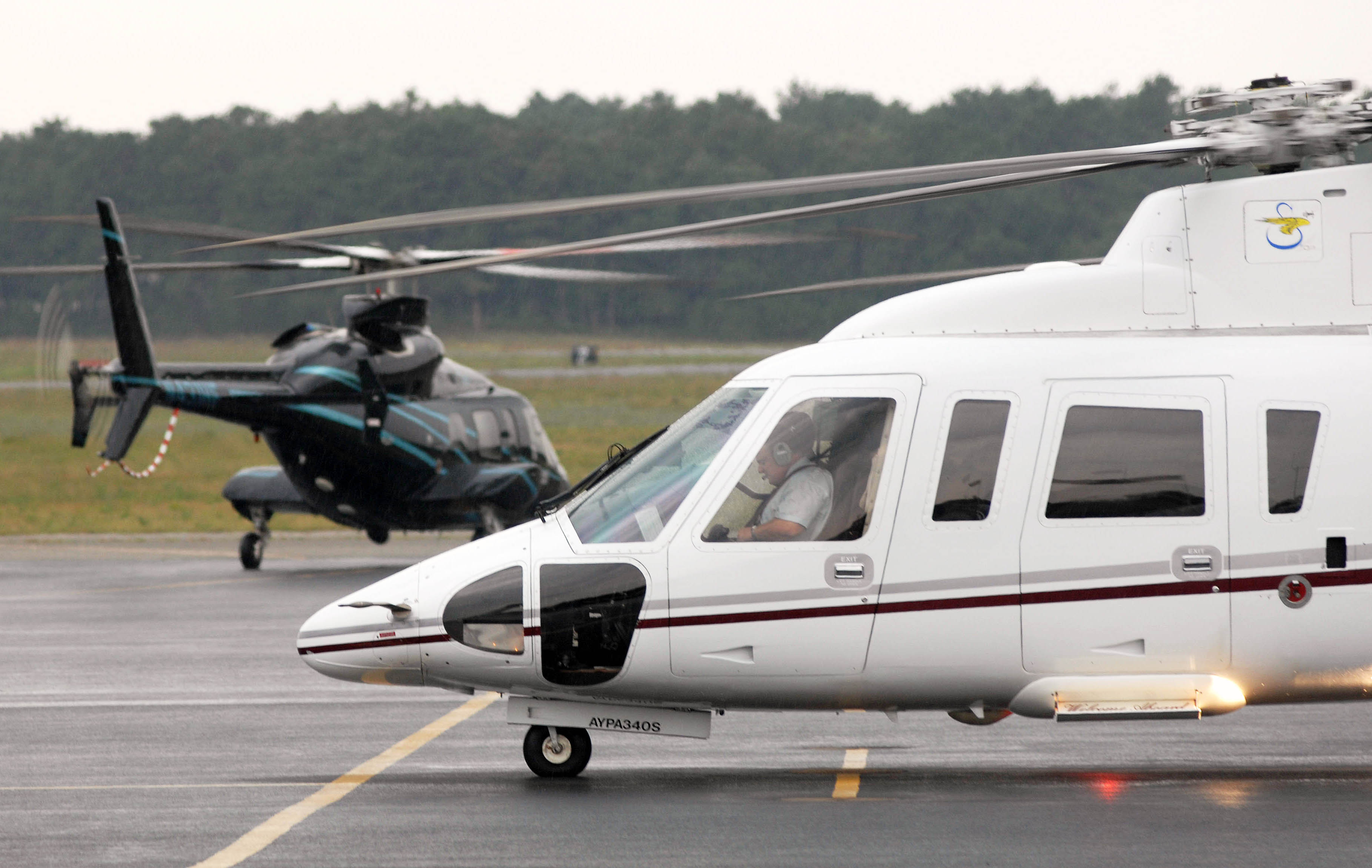 Helicopters prepare to depart the East Hampton Airport in East Hampton, New York, on Aug. 13, 2007.