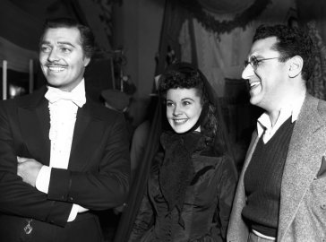 From left: Clark Gable, Vivien Leigh and producer David O. Selznick on the set of Gone with the Wind in 1939.