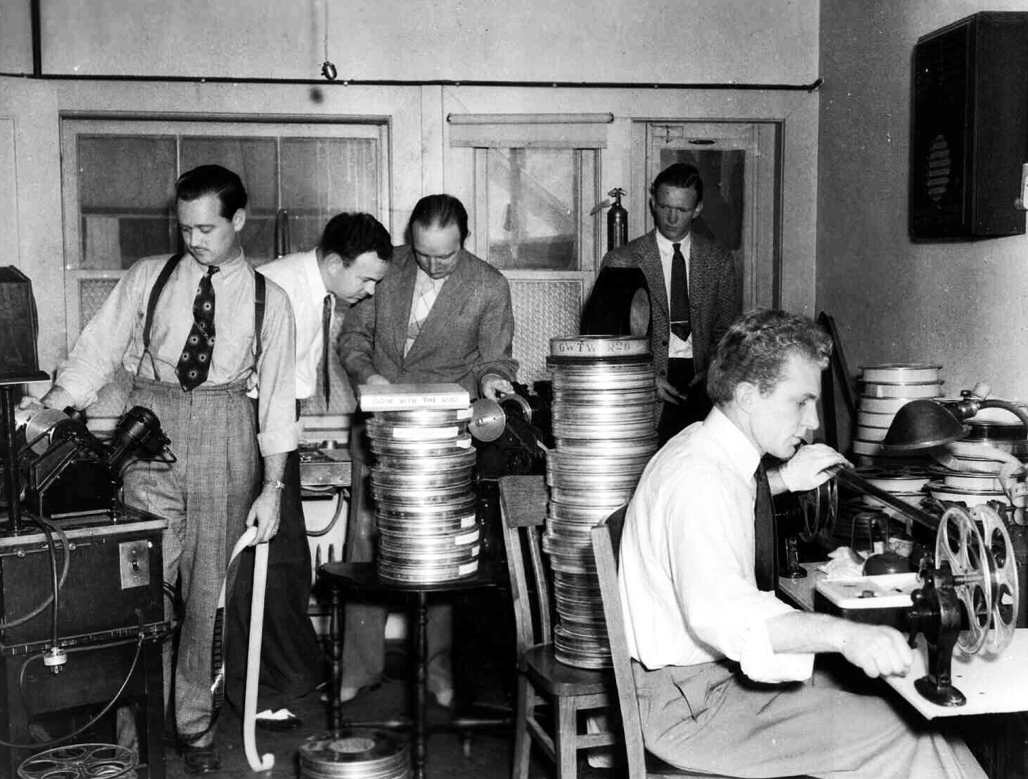 Film Editor Hal C. Kern, third from left, and others, edit Gone with the Wind in 1939.