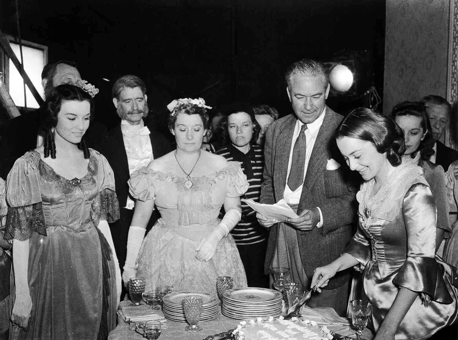 Victor Fleming, second from right, and Olivia de Havilland, right, on the set of Gone with the Wind in 1939.