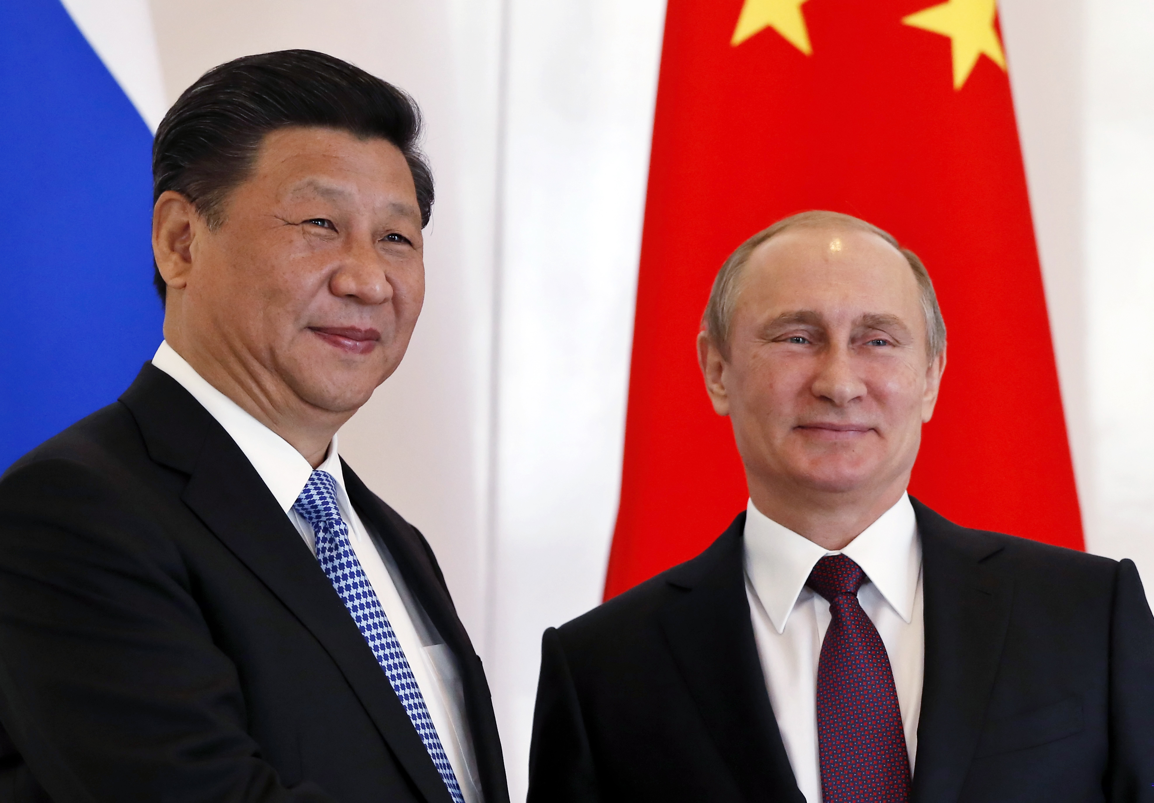 Russian President, Vladimir Putin, right, poses with Chinese President Xi Jinping during the BRICS leaders' meeting in Turkey on Nov. 15, 2015