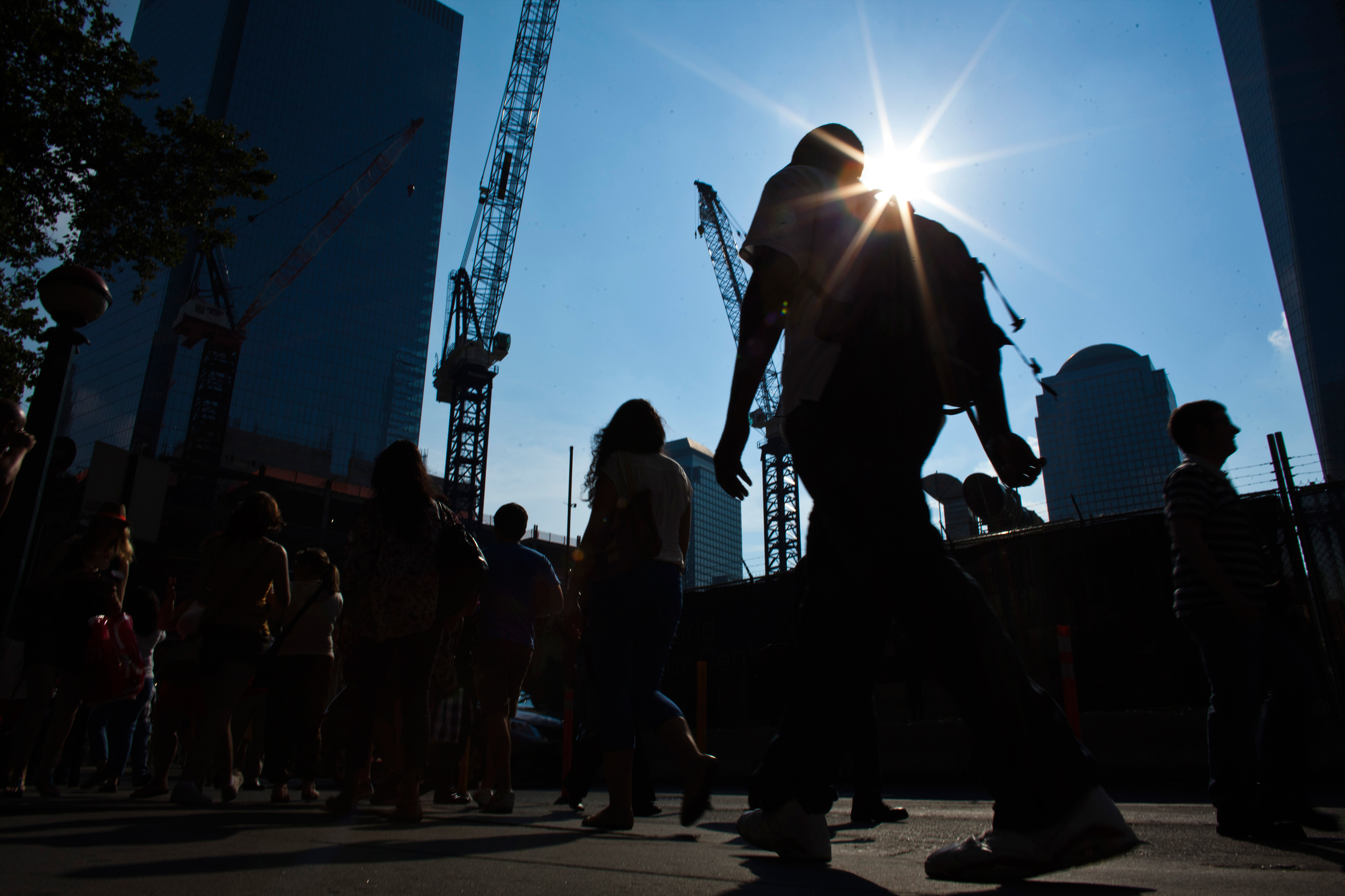 People walk near the World Trade Center during a heat wave in New York July 19, 2013.