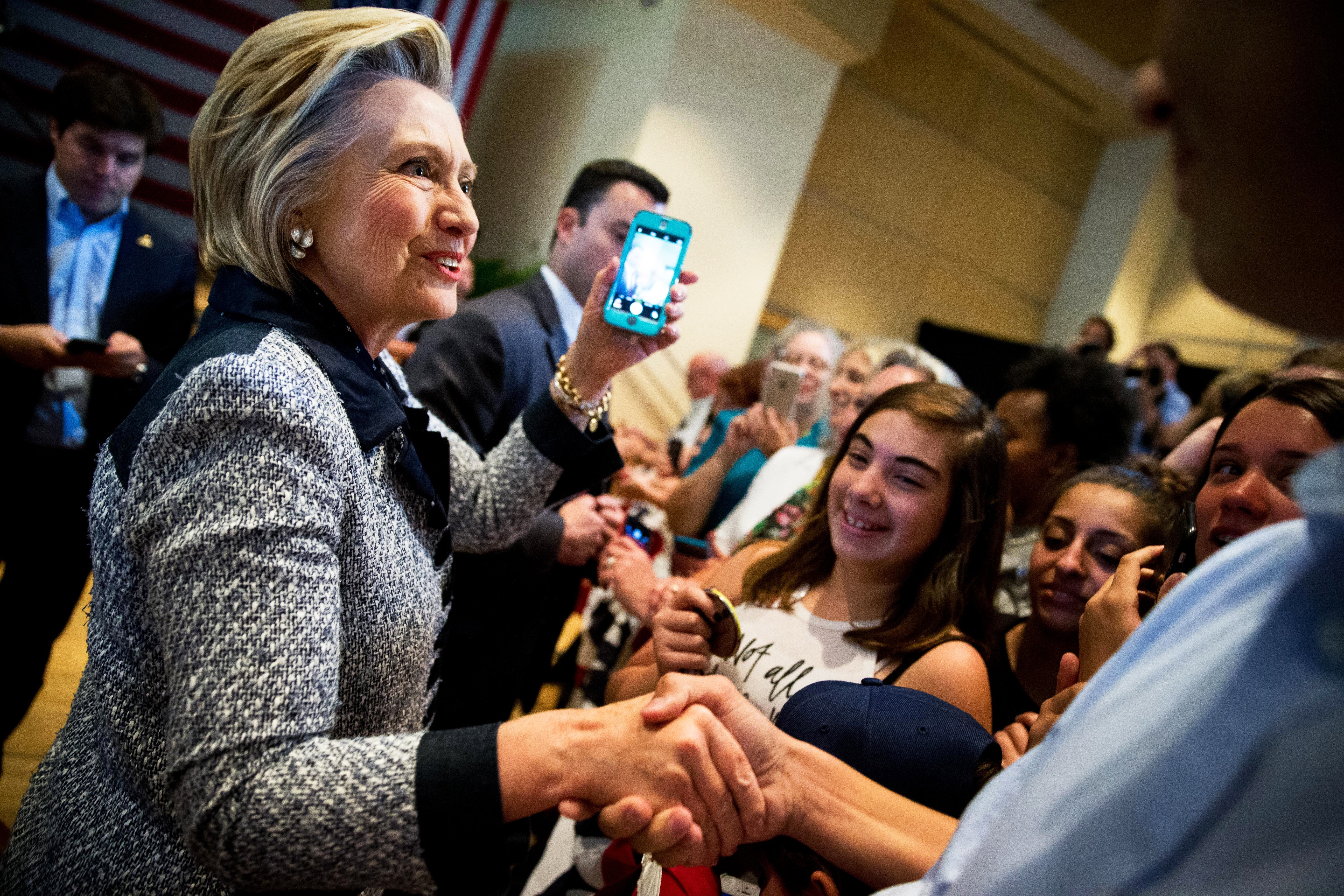 Hillary Clinton greets members of the audience after speaking at a rally at the International Brotherhood of Electrical Workers Circuit Center in Pittsburgh on June 14, 2016.