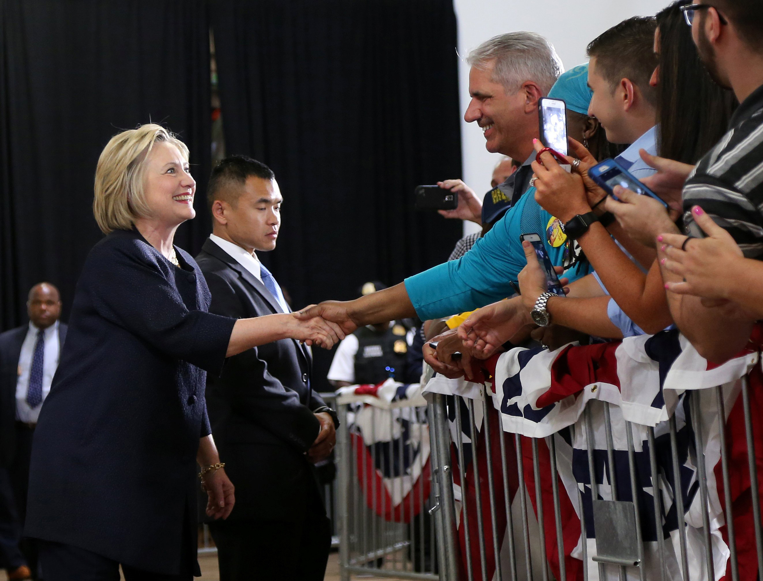 Democratic U.S. presidential candidate Hillary Clinton shakes hands with supporters before speaking at a campaign rally in Cleveland on June 13, 2016.